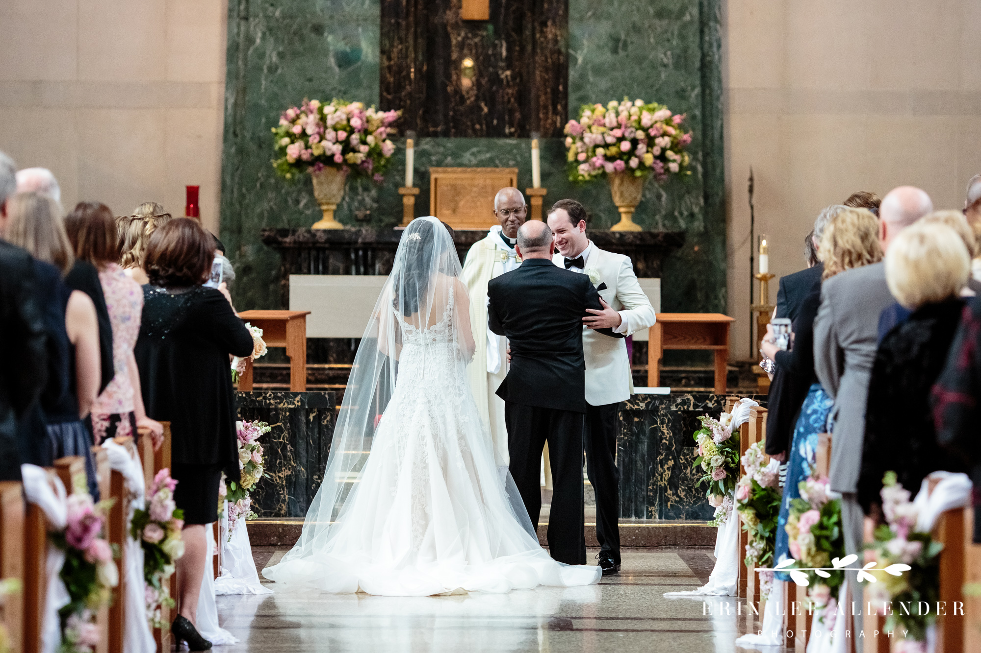groom-hugs-father-of-the-bride