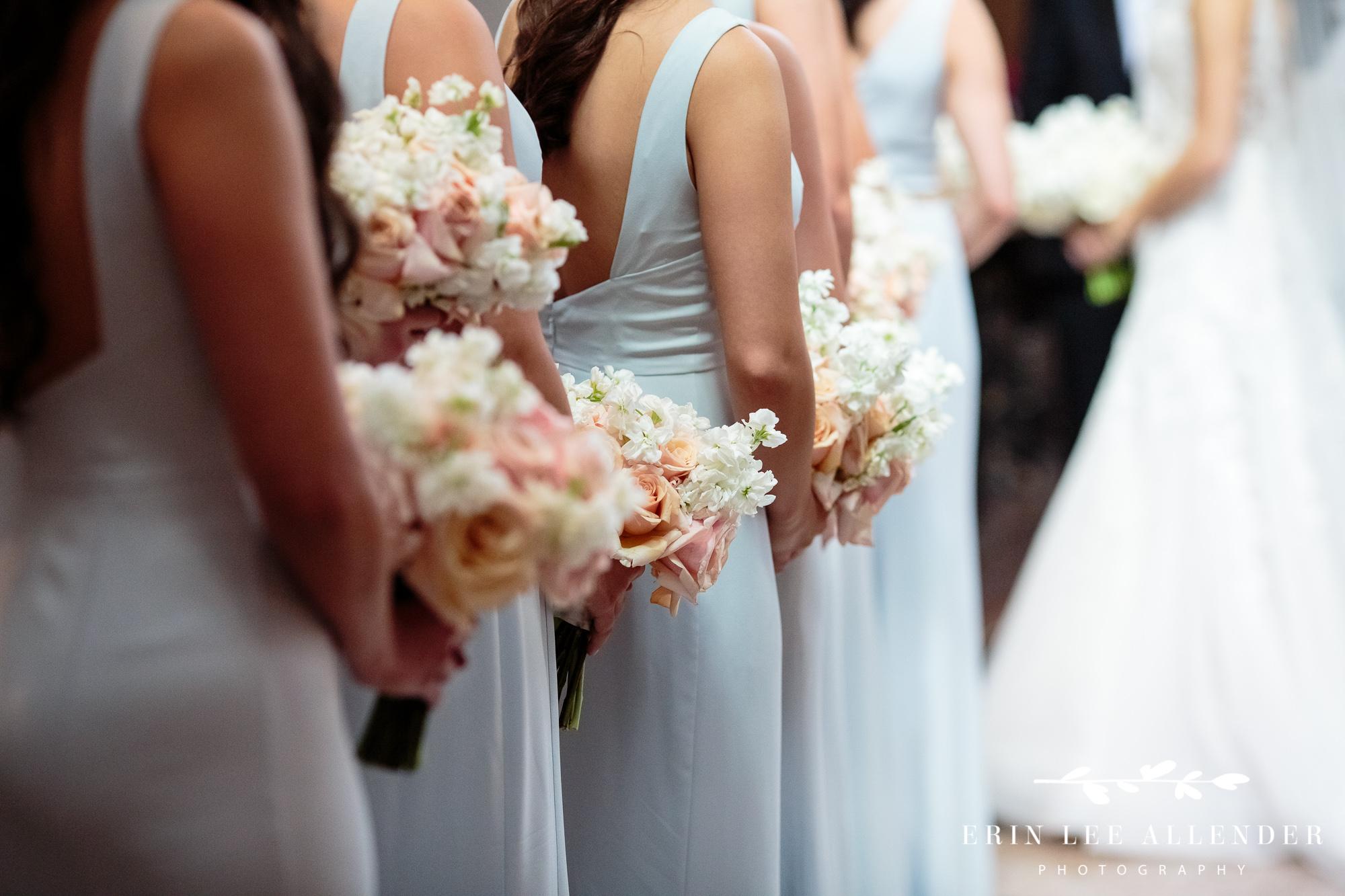 bridesmaids-holding-flowers
