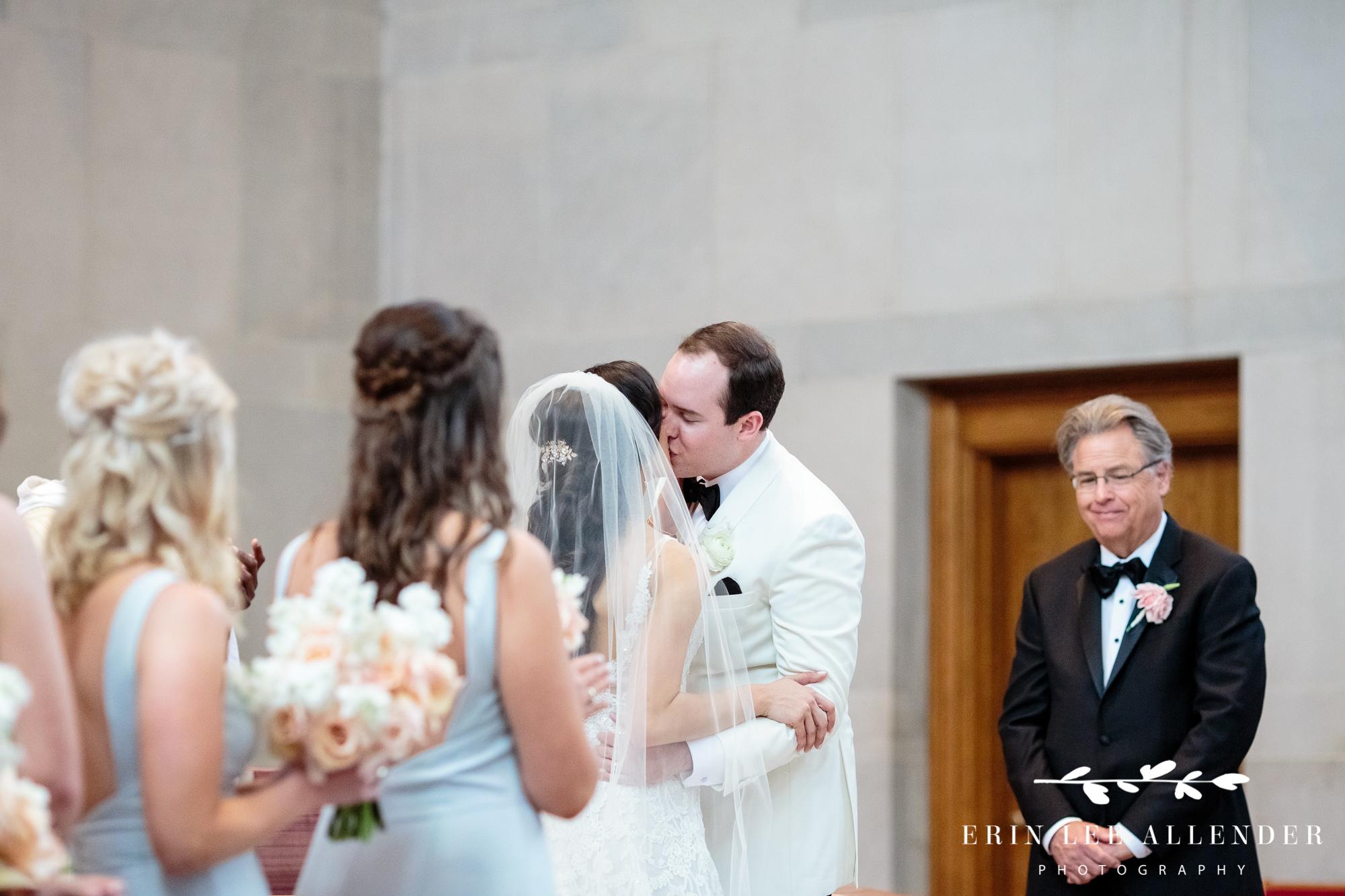 Bride-groom-kiss-at-alter