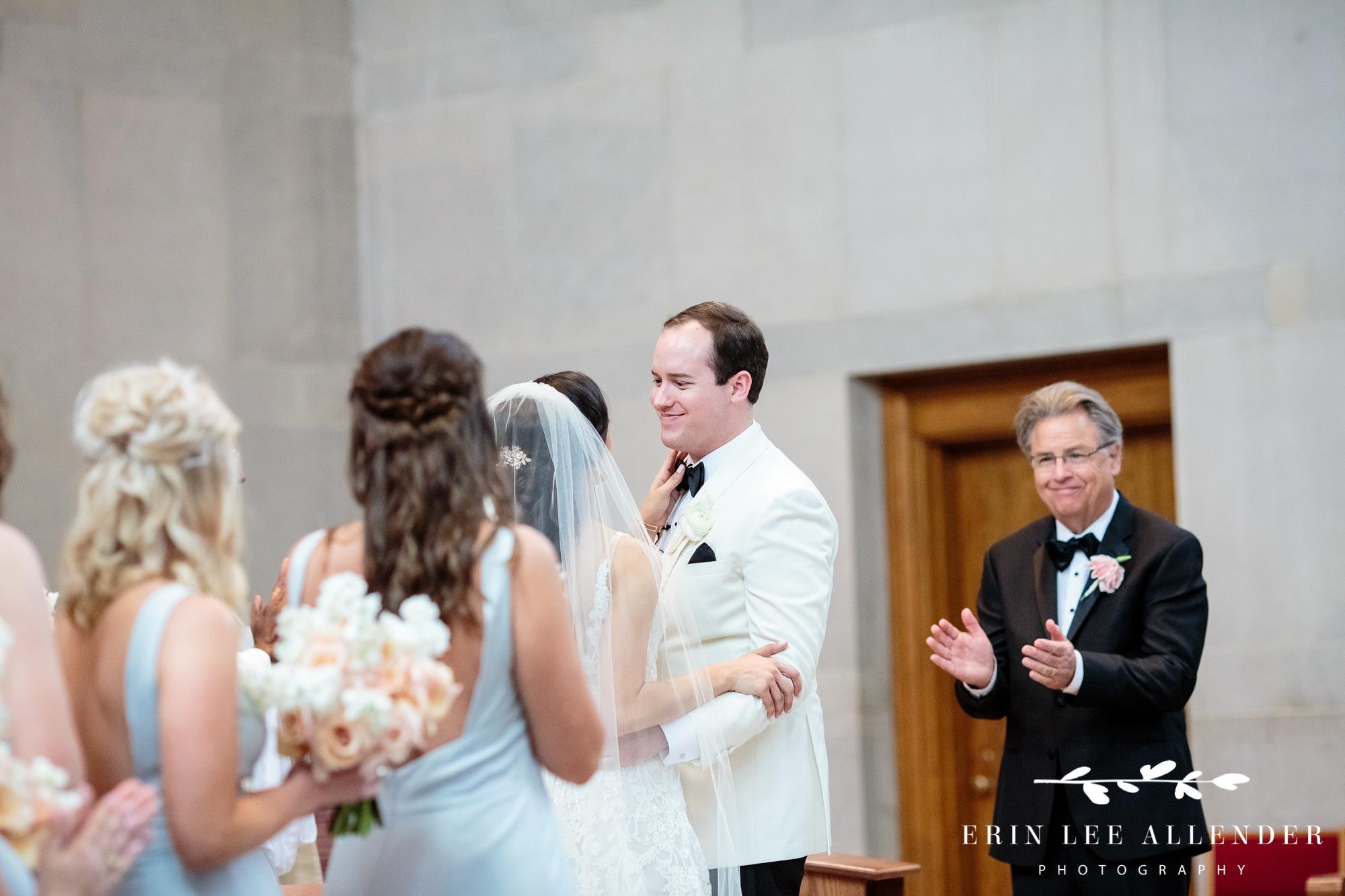 groom-looks-at bride-post-kiss