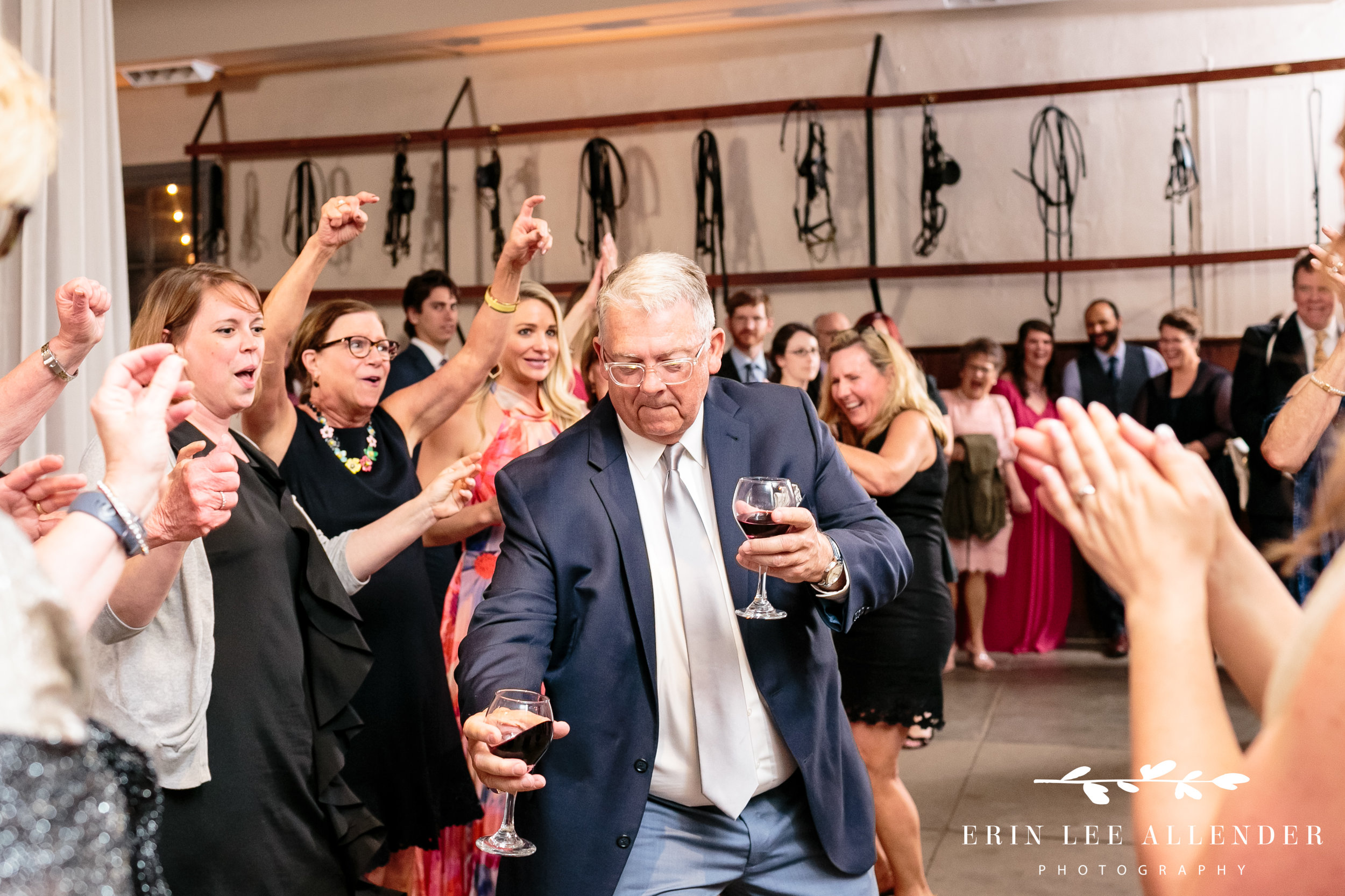 guest-dancing-with-two-wine-glassed