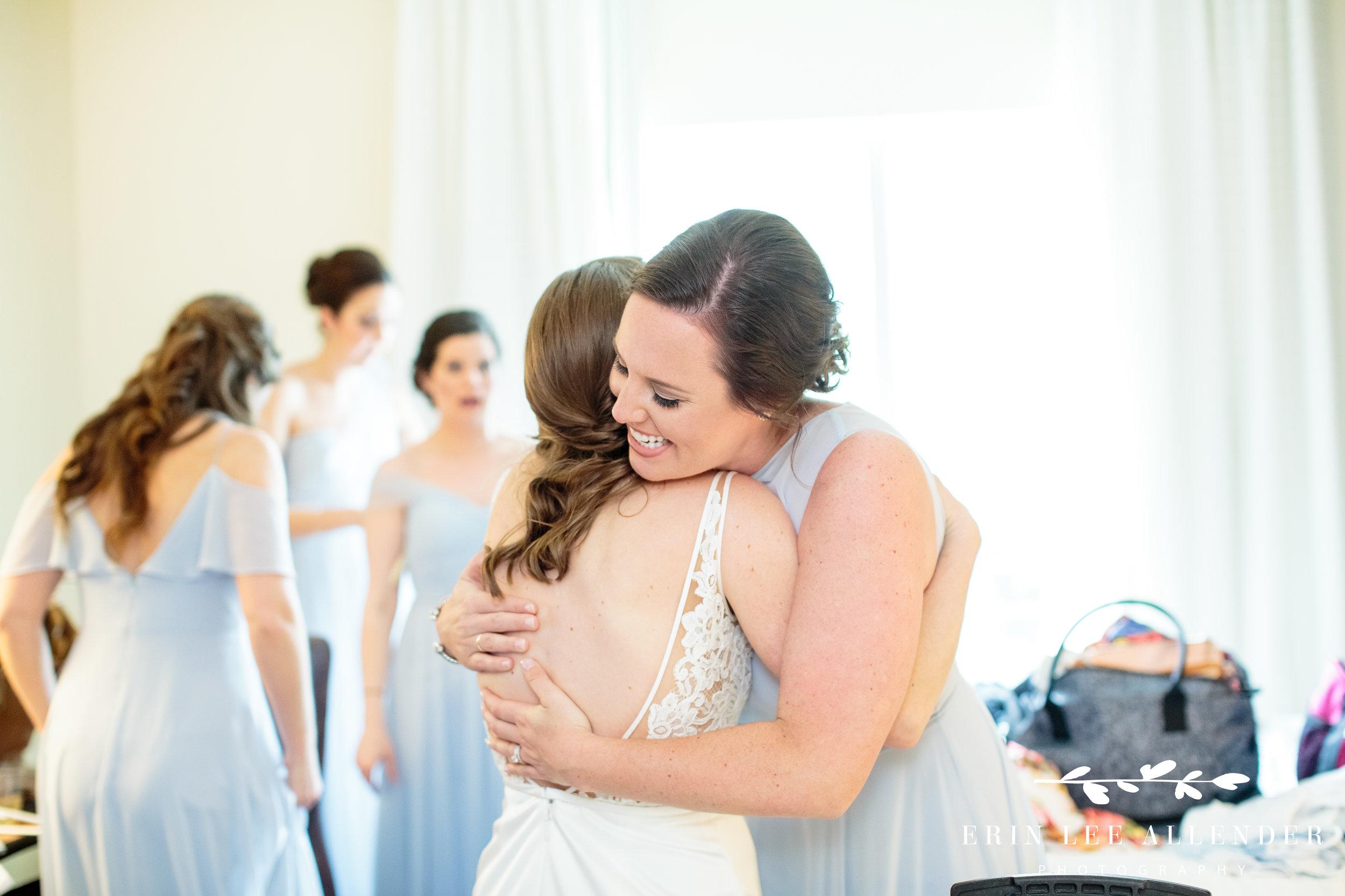 bridesmaid-hugs-bride
