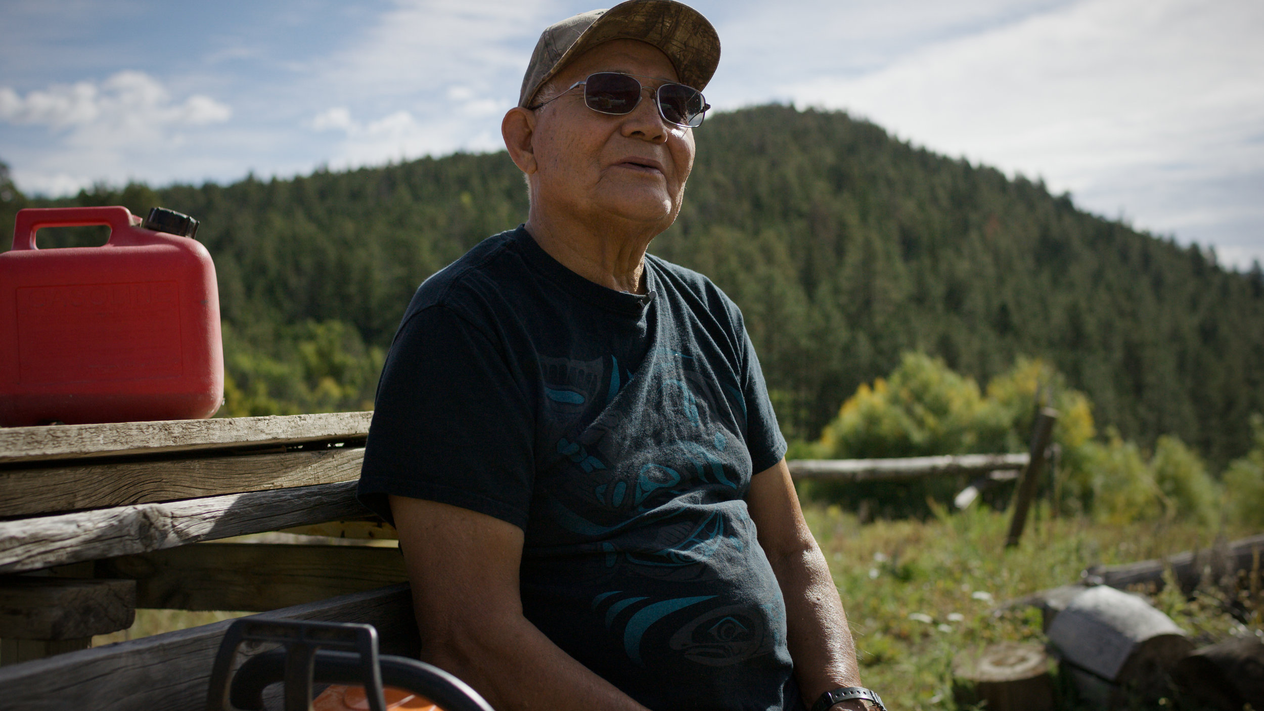 Tito Naranjo takes a break from chopping wood to share memories of his life.