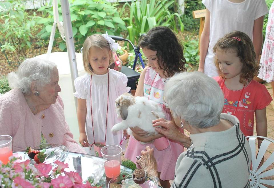 Tea2016_Sarah Belk Gambrell, Mary Coff and friends play with a bunny.jpg