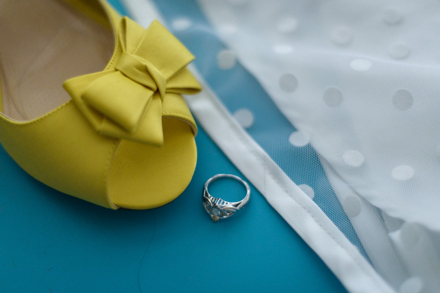 Detail of bride's yellow shoes, polka dot dress and silver ring in fairfax, virginia