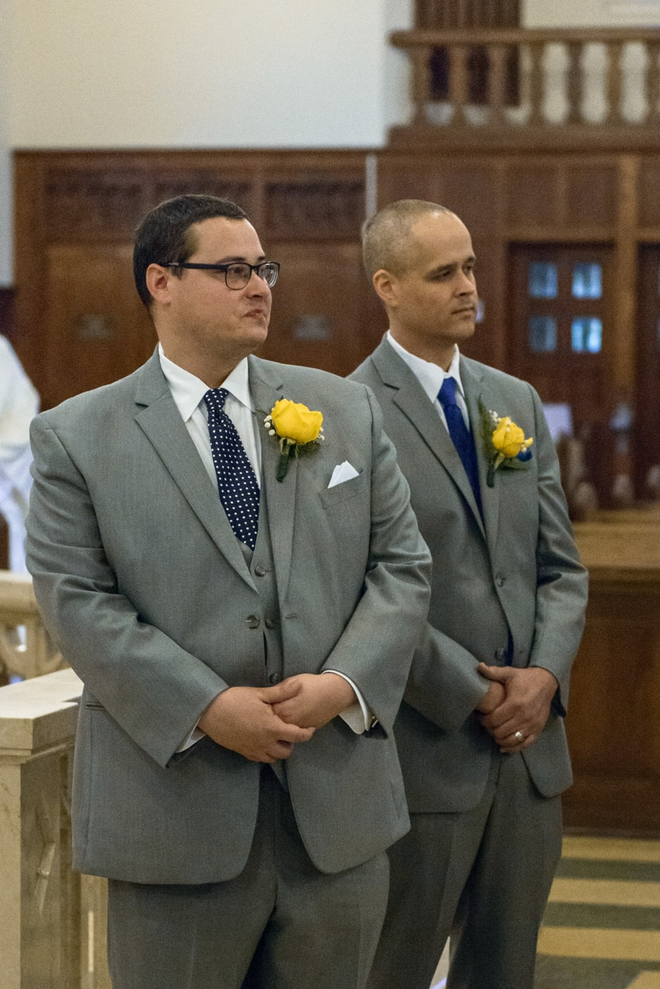 The groom gets emotional as he sees his bride walk down the aisle at St James Catholic Church in Falls Church, Virginia