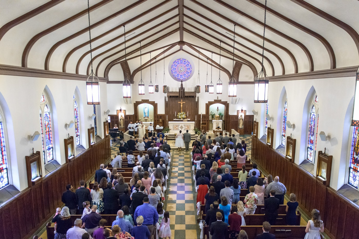 Wide angle shot of wedding ceremony at St James Catholic Church in Falls Church, Virginia