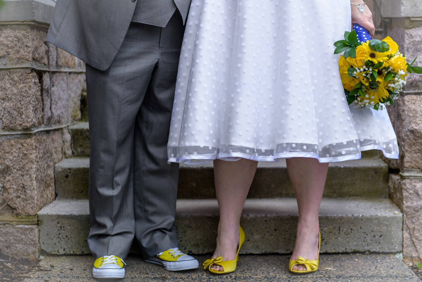 Close up of the bride and groom's details including tea length wedding dress and yellow shoes