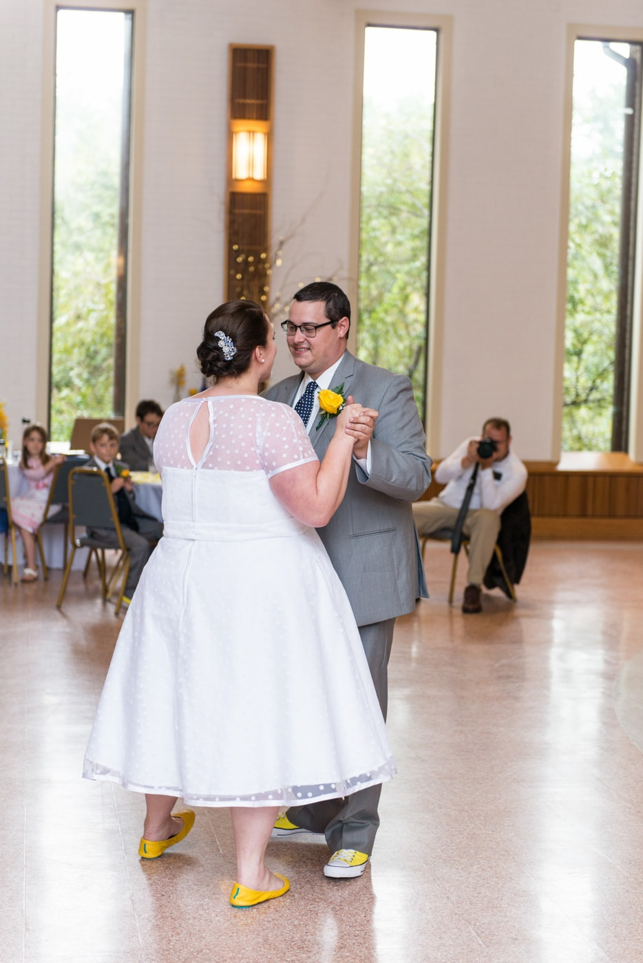 The bride and groom dance together at their wedding reception at St Mark Catholic Church in Vienna, Virginia