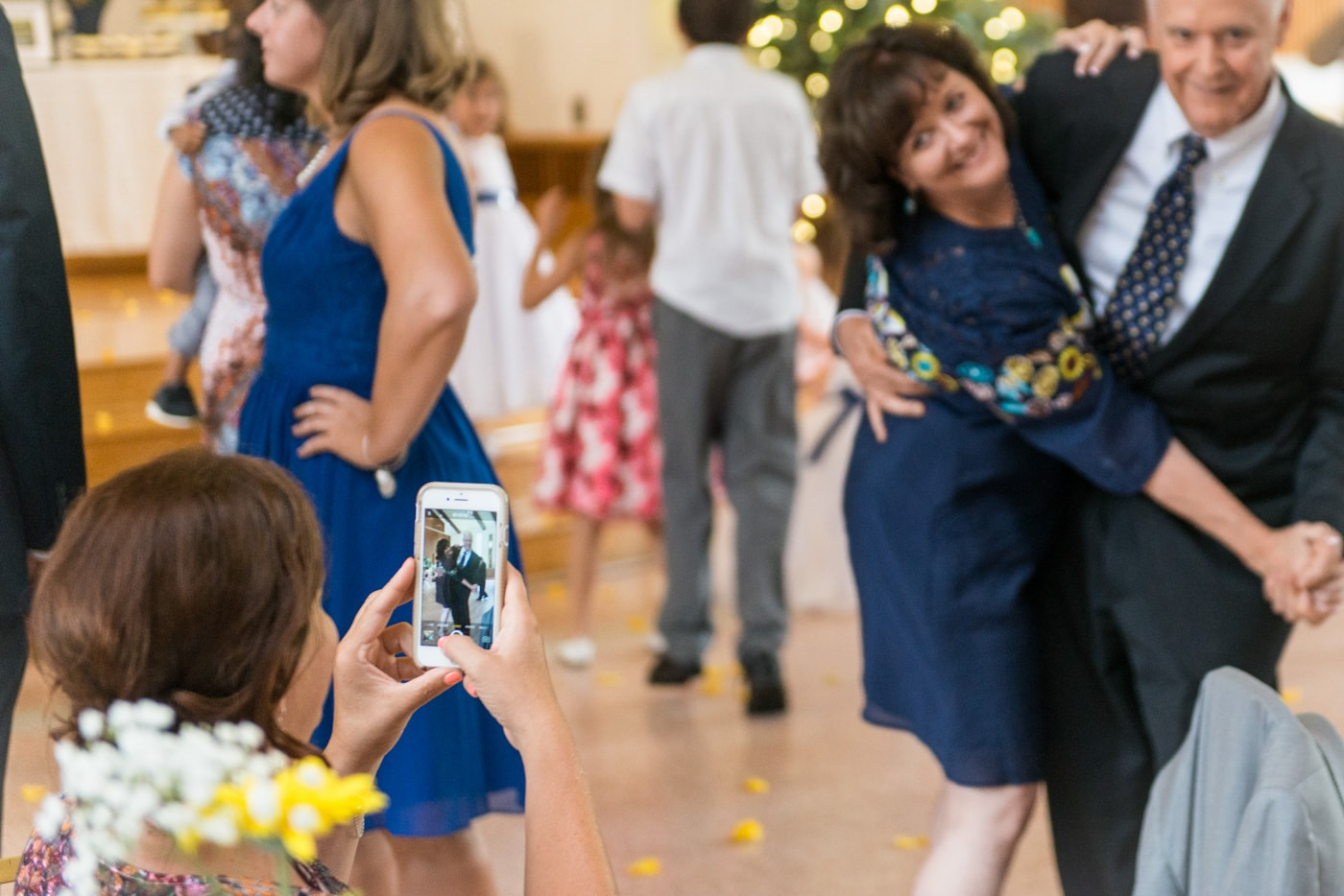 A couple dancing and posing for a camera at a wedding reception at St Mark Catholic Church in Vienna