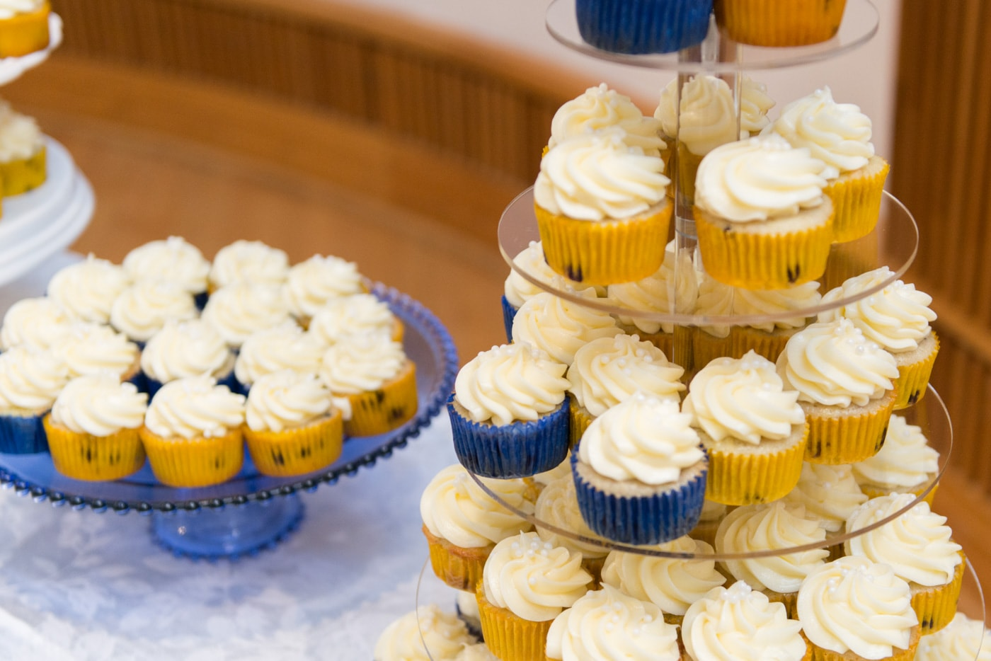 Blueberry cupcakes with vanilla frosting at a wedding reception at St Mark Catholic Church in Vienna, Virginia