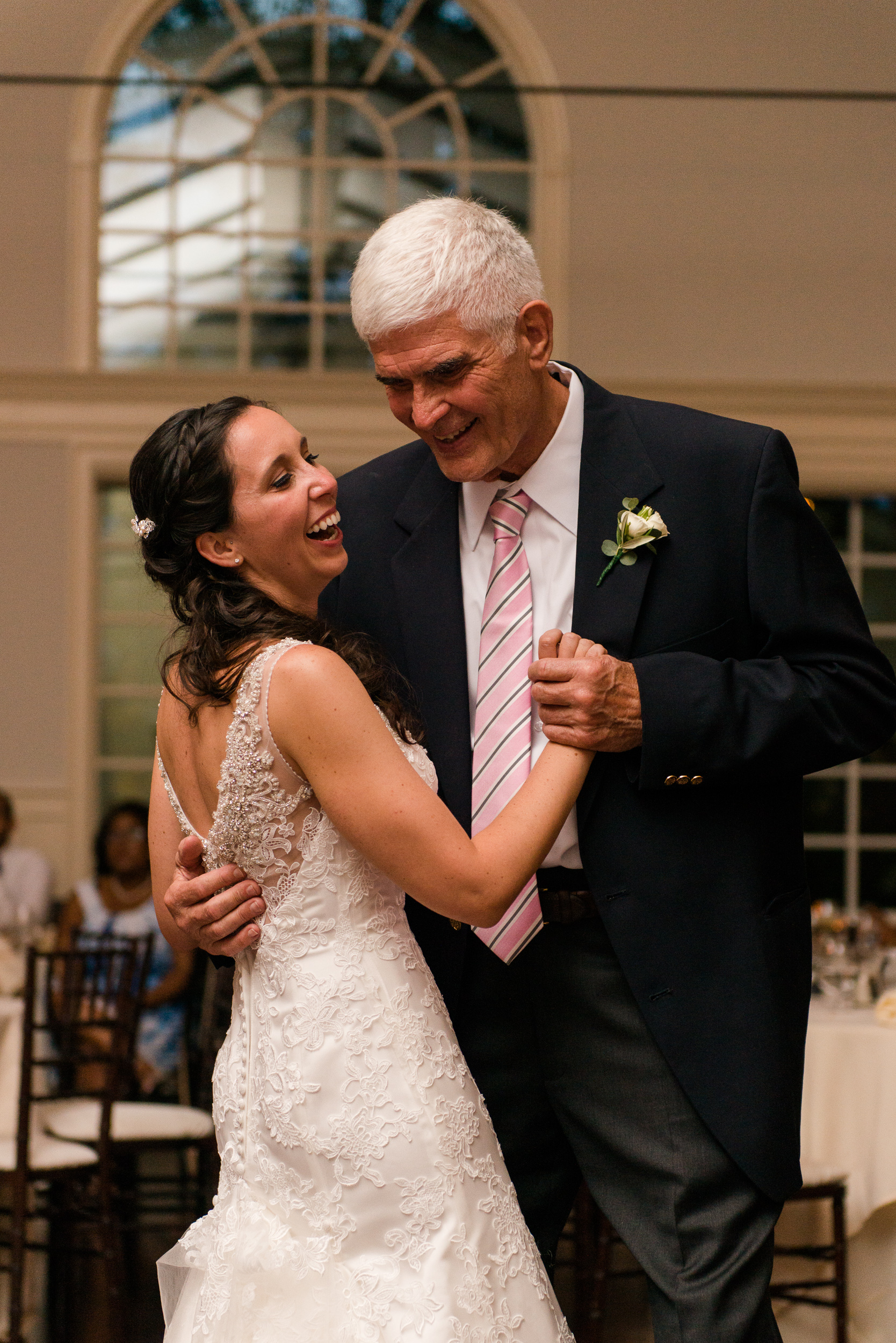 The bride and her father dance together in a ballroom wedding reception at the chesapeake bay beach club in stevensville, md