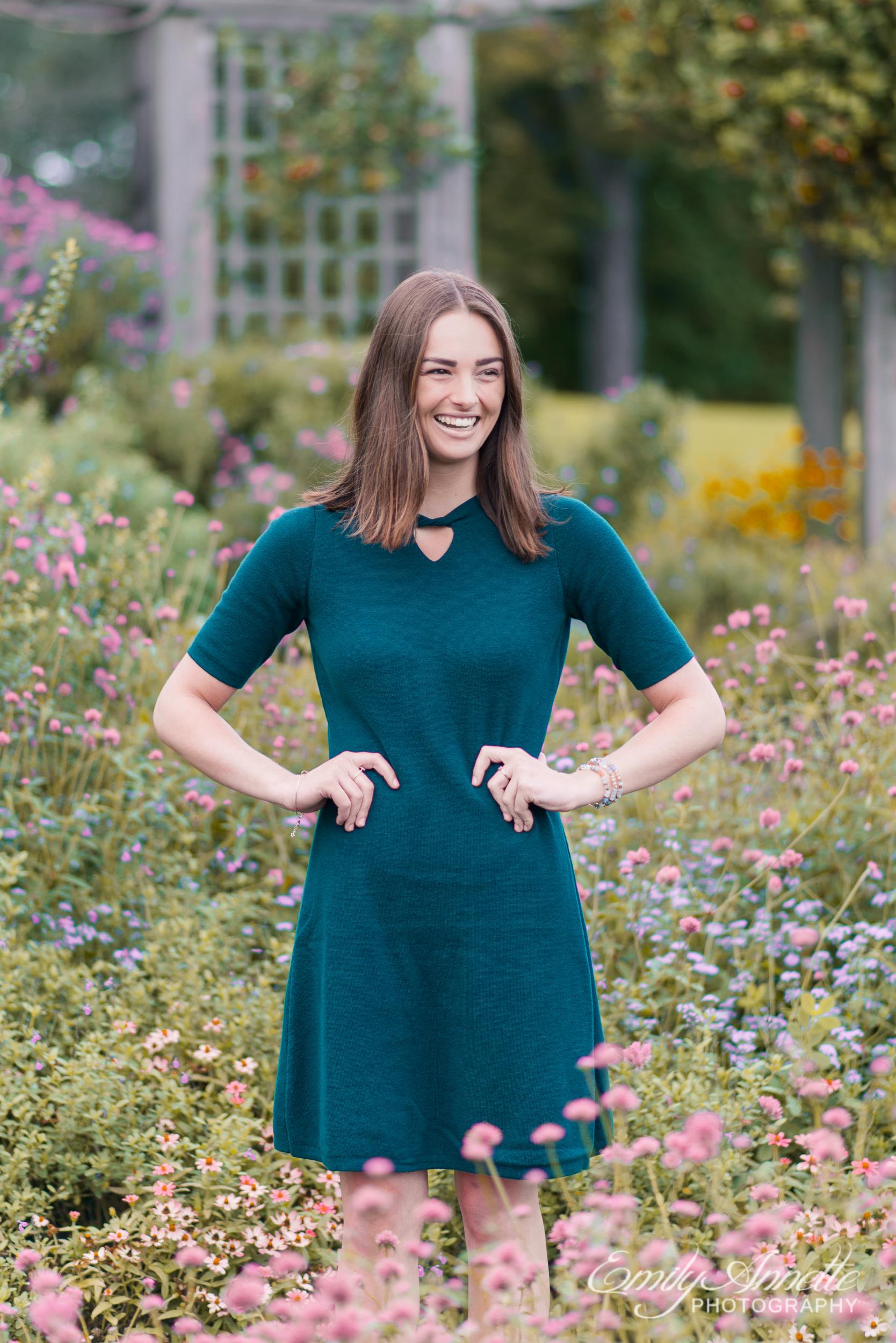 A young woman stands in a lush garden in Green Spring Gardens in Fairfax, Virginia