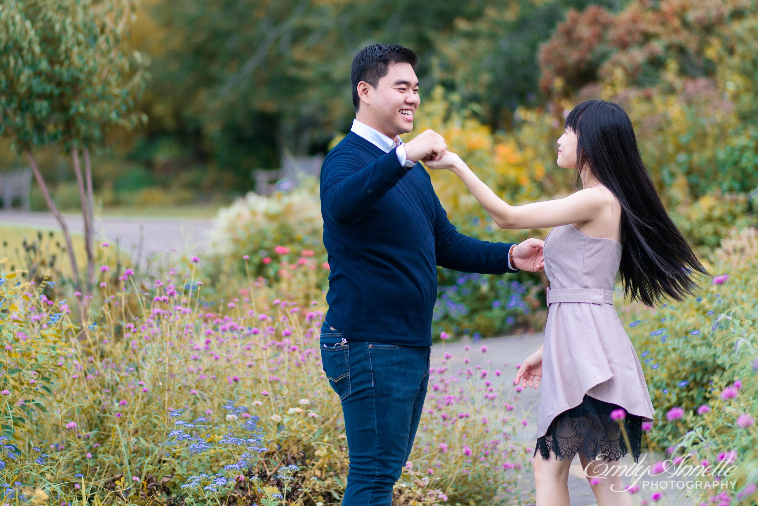 A young couple dance in the gardens at Green Spring Gardens Park in Fairfax, Virginia