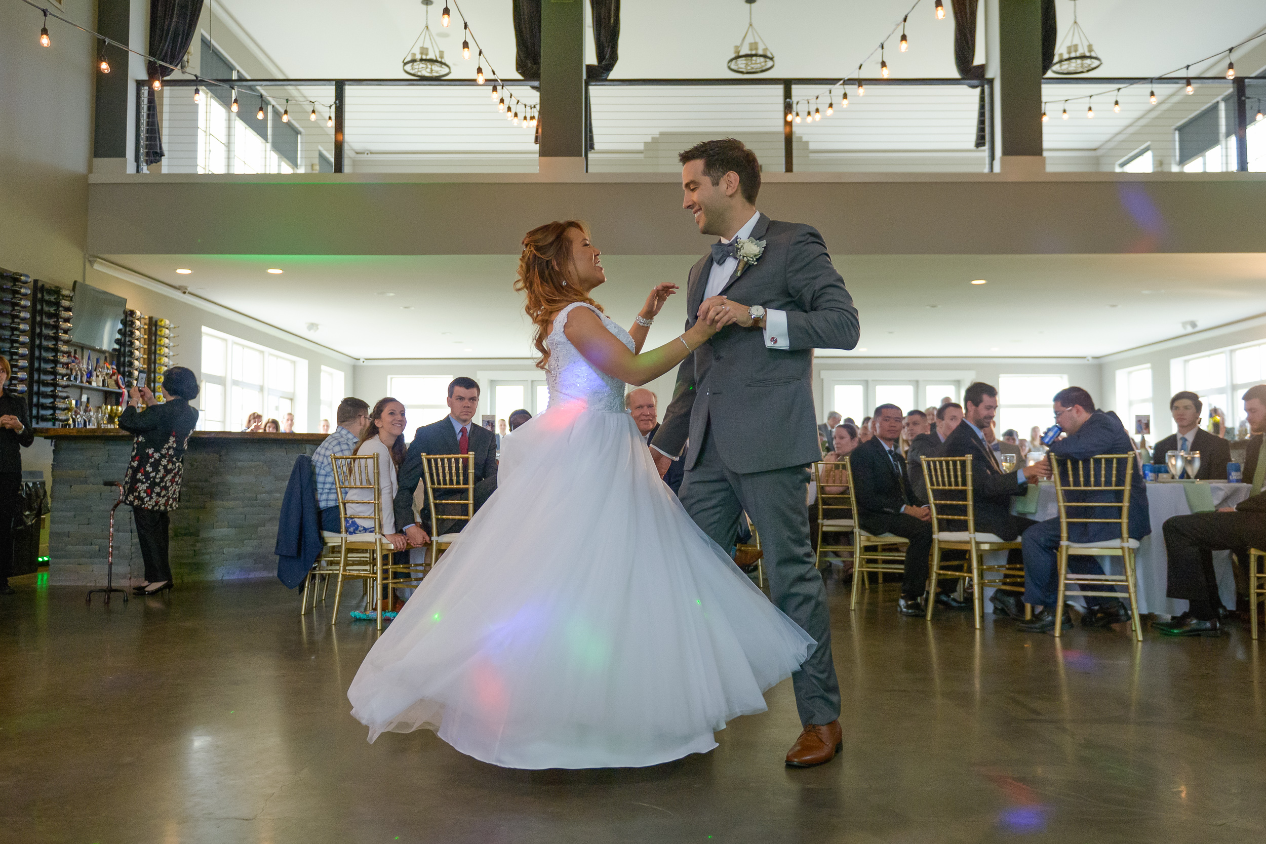 A bride and groom share their first dance as husband and wife at a reception at Blue Valley Vineyard and Winery in Delaplane, Virginia
