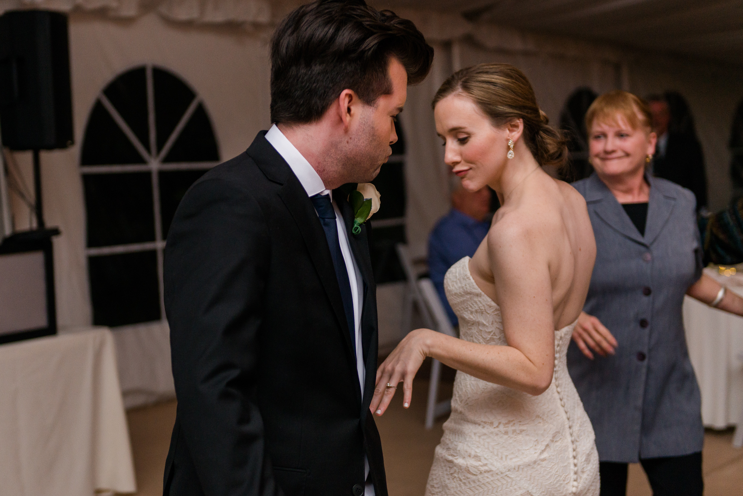 The bride and groom have fun dancing together during their tented reception at Oatlands Historic House and Gardens in Leesburg, Virginia