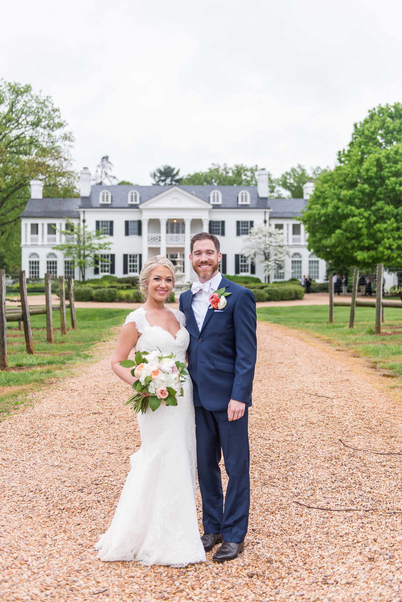The bride and groom pose for a classic portrait outside Keswick Vineyards in Charlottesville, Virginia