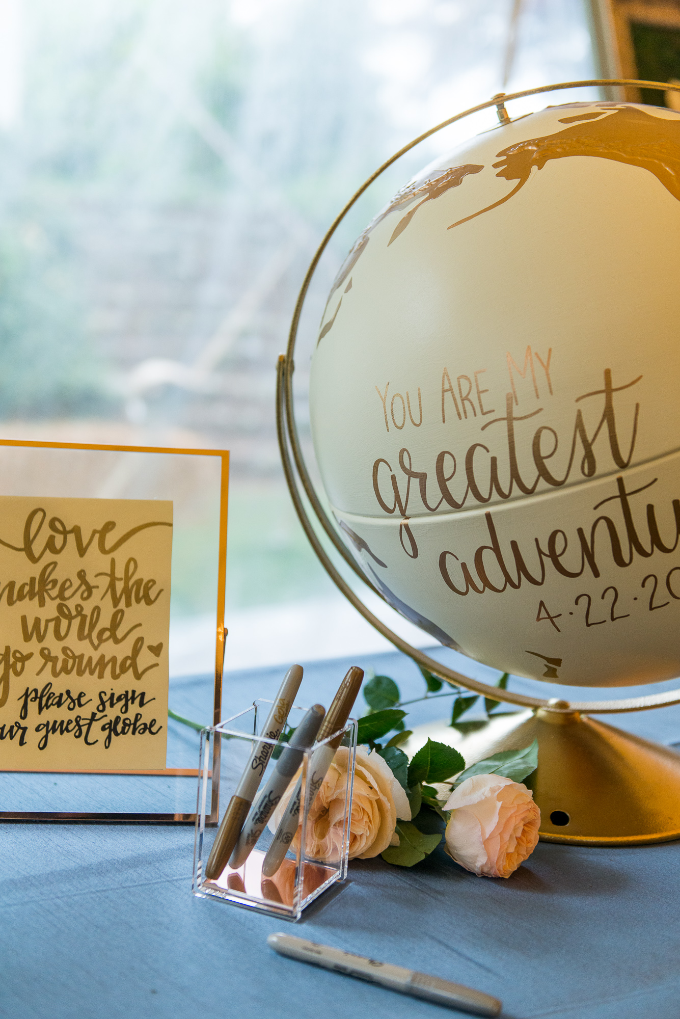 Adventure themed decorations including a globe as a guest book at a reception at Keswick Vineyards in Charlottesville, Virginia