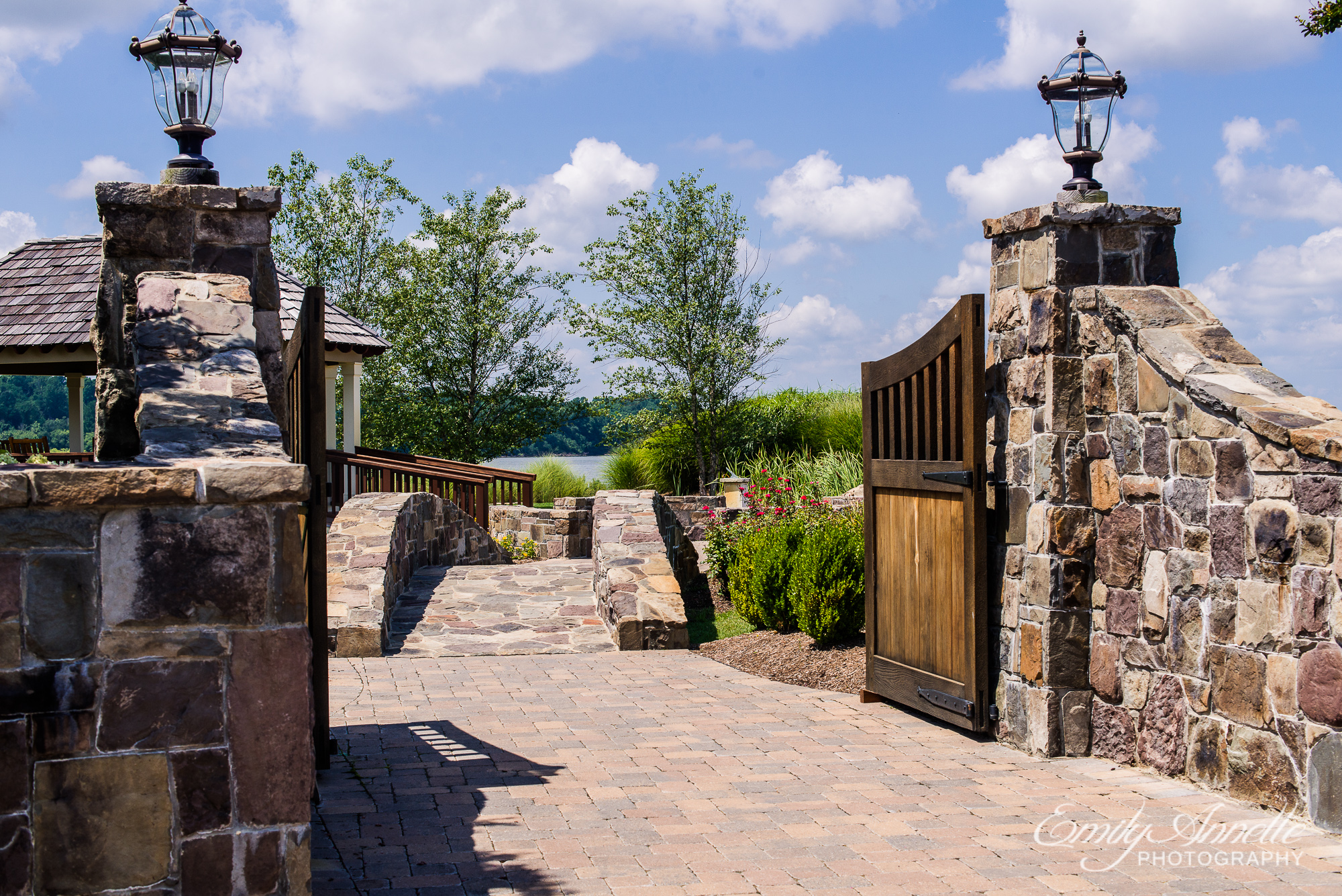 A beautiful view of a gate and stone bridge at Herrington on the Bay in North Beach, Maryland