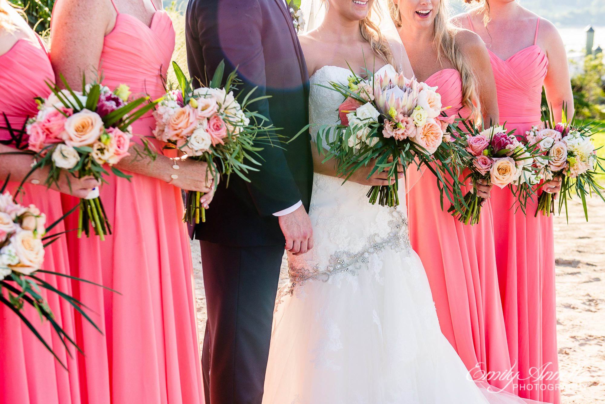 Details of the tropical flower bouquets and coral bridesmaids dresses at Herrington on the Bay in North Beach, Maryland