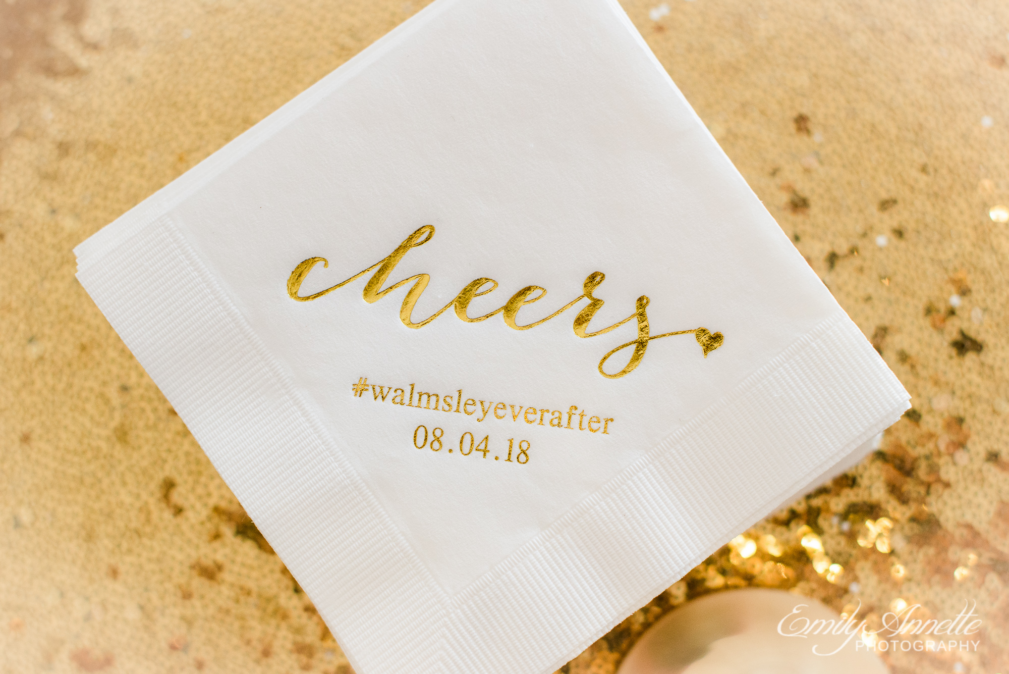Personalized napkins that say cheers with the wedding date during a reception at Herrington on the Bay in North Beach, Maryland