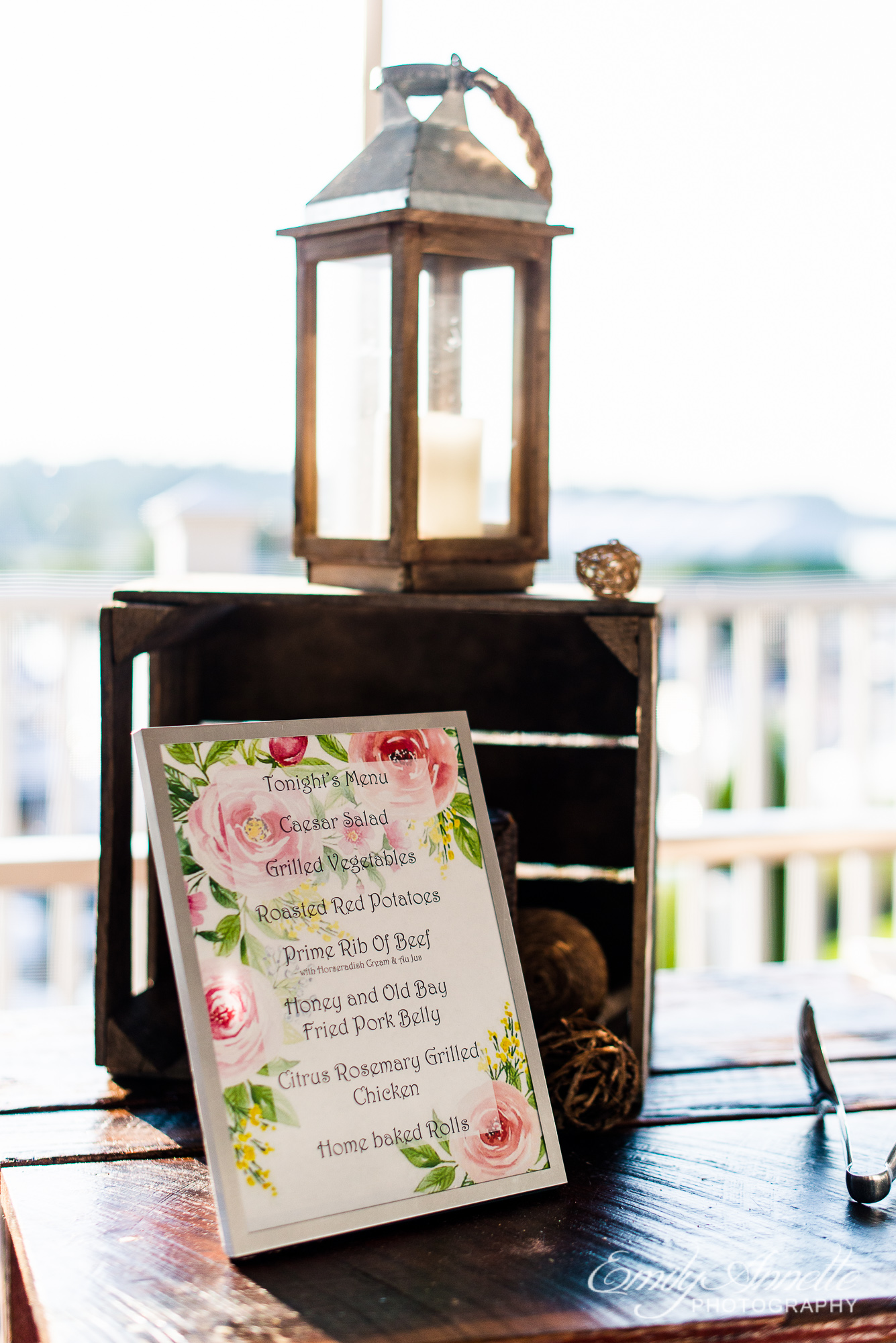 Decorations including a lantern and floral menu at the buffet bar for a wedding reception at Herrington on the Bay in North Beach, Maryland