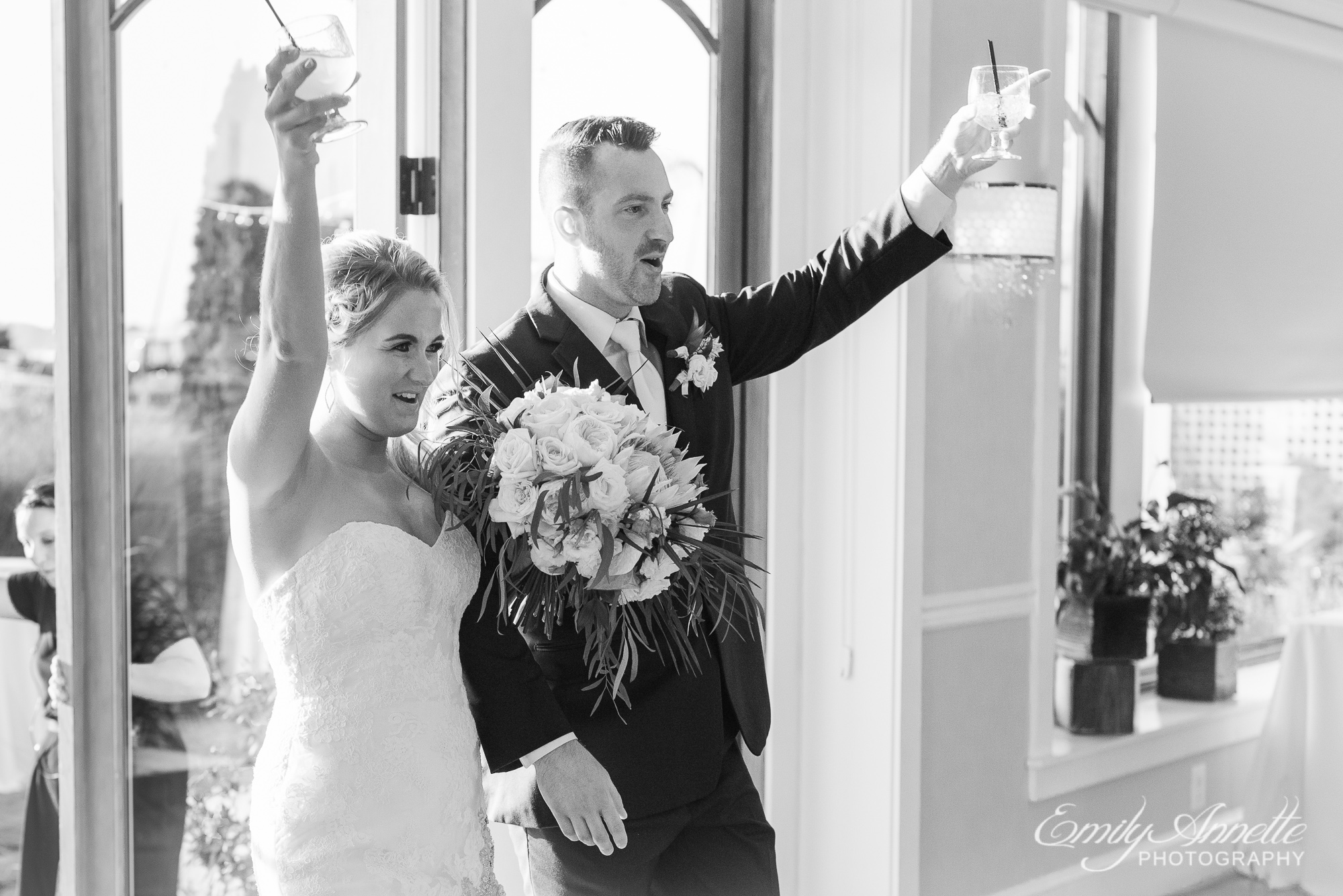 A bride and groom celebrating and cheering as they make their entrance to the wedding reception at Herrington on the Bay in North Beach, Maryland