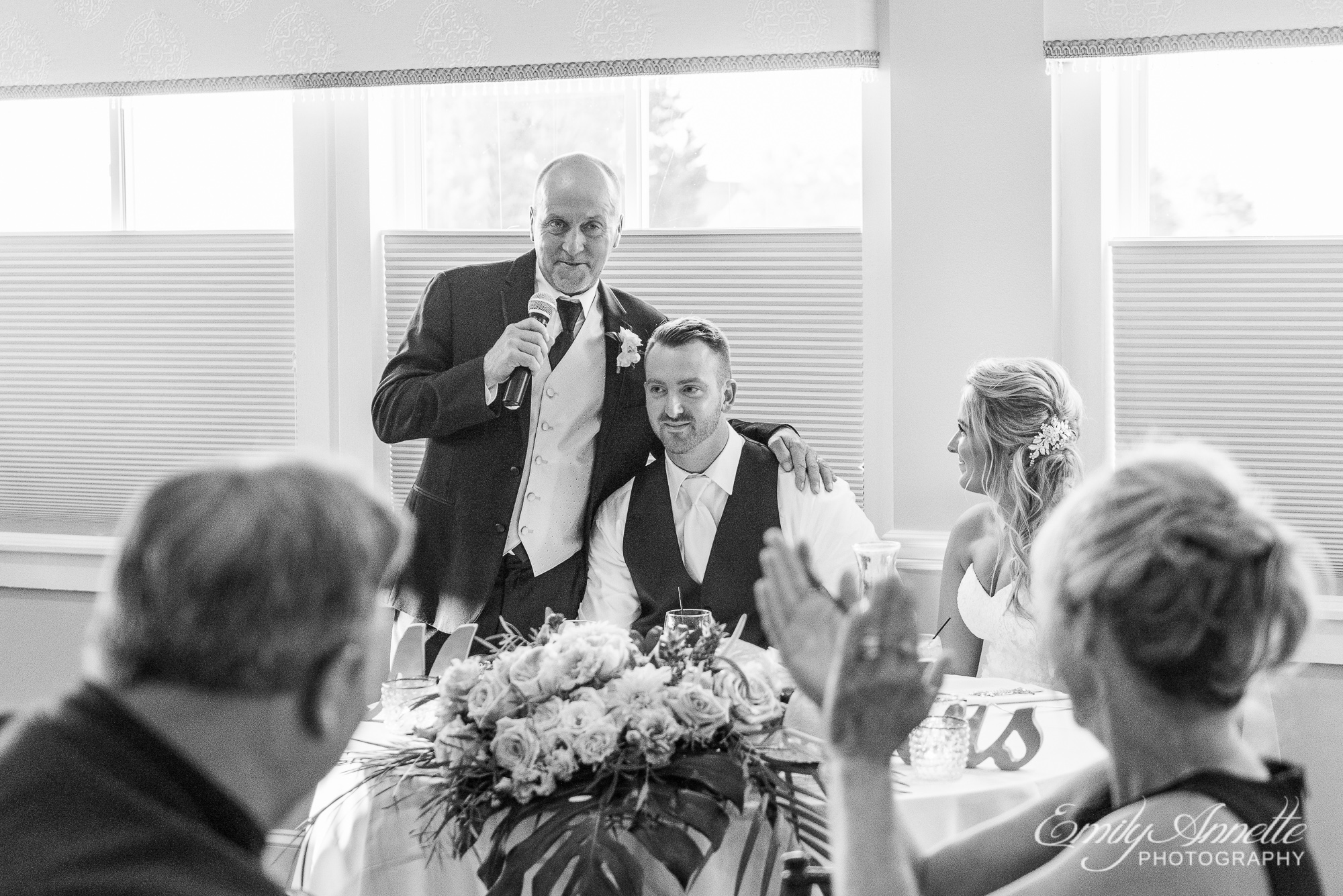 The father of the bride gives a welcome blessing during the wedding reception at Herrington on the Bay in North Beach, Maryland