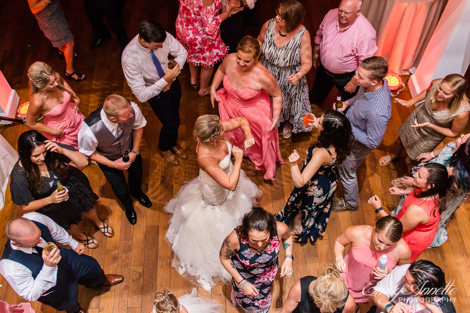 A view from above of the bride and guests dancing during a wedding reception at Herrington on the Bay in North Beach, Maryland
