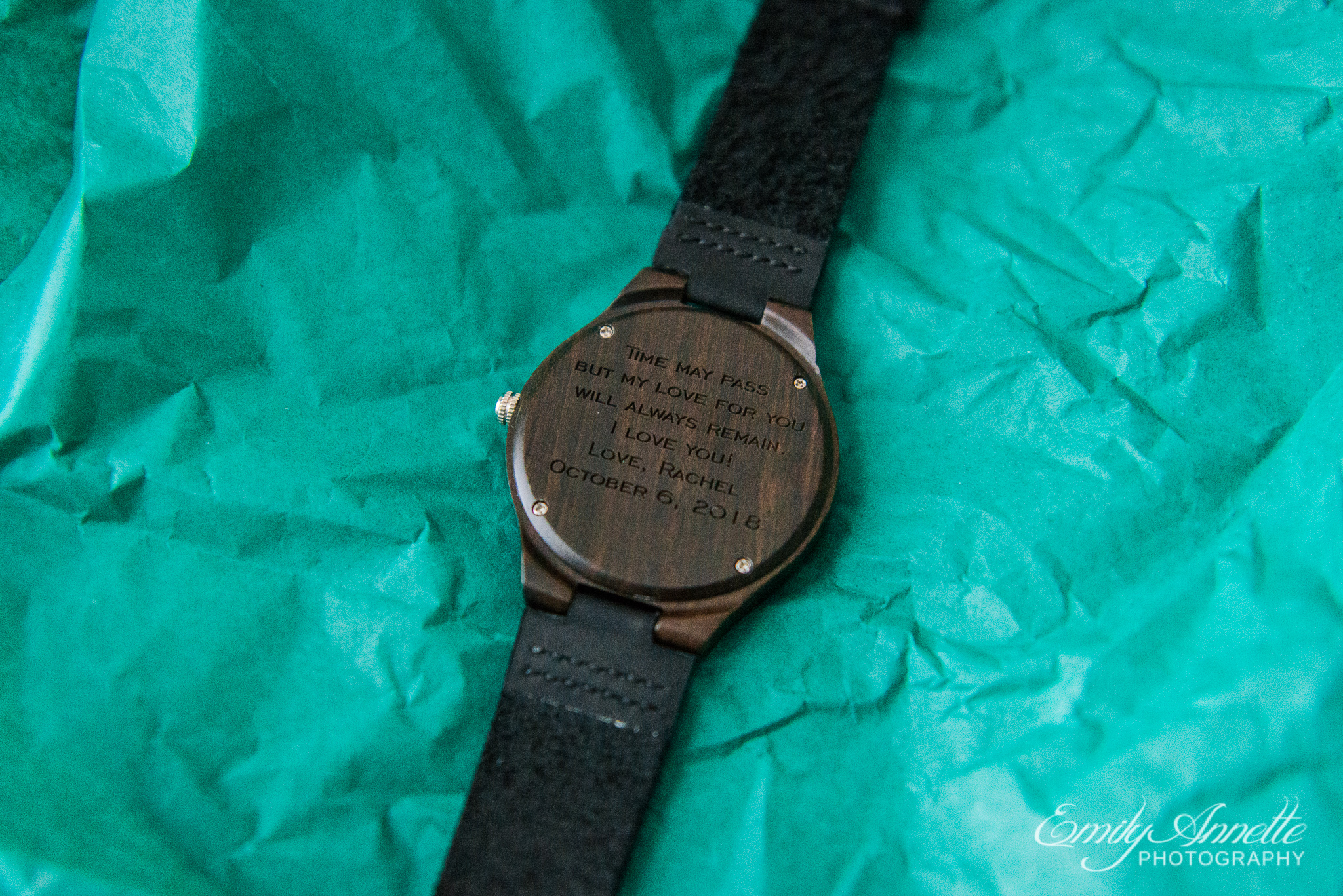 A personalized engraved wooden watch given to the groom from the bride before their wedding ceremony at Amber Grove near Richmond, Virginia