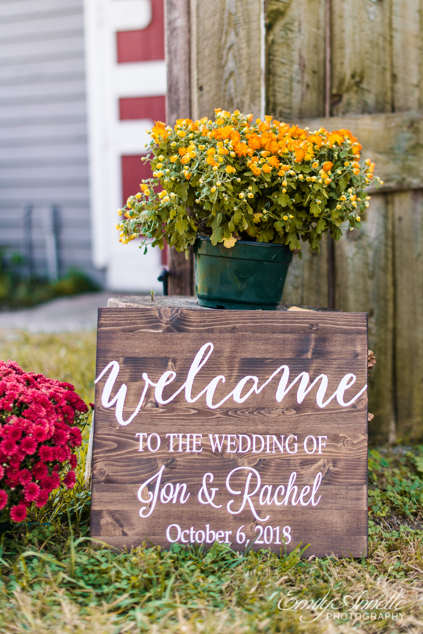 A wooden welcome sign outside the ceremony site during a country wedding at Amber Grove near Richmond, Virginia