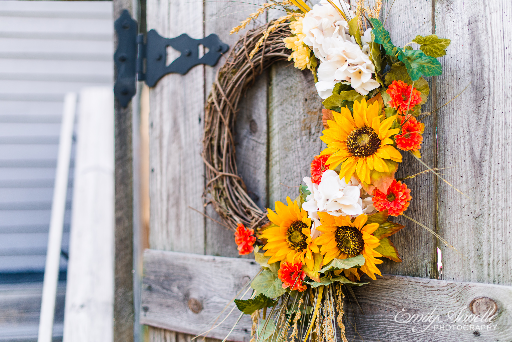 A fall wreath hanging outside the ceremony site during a country wedding at Amber Grove near Richmond, Virginia