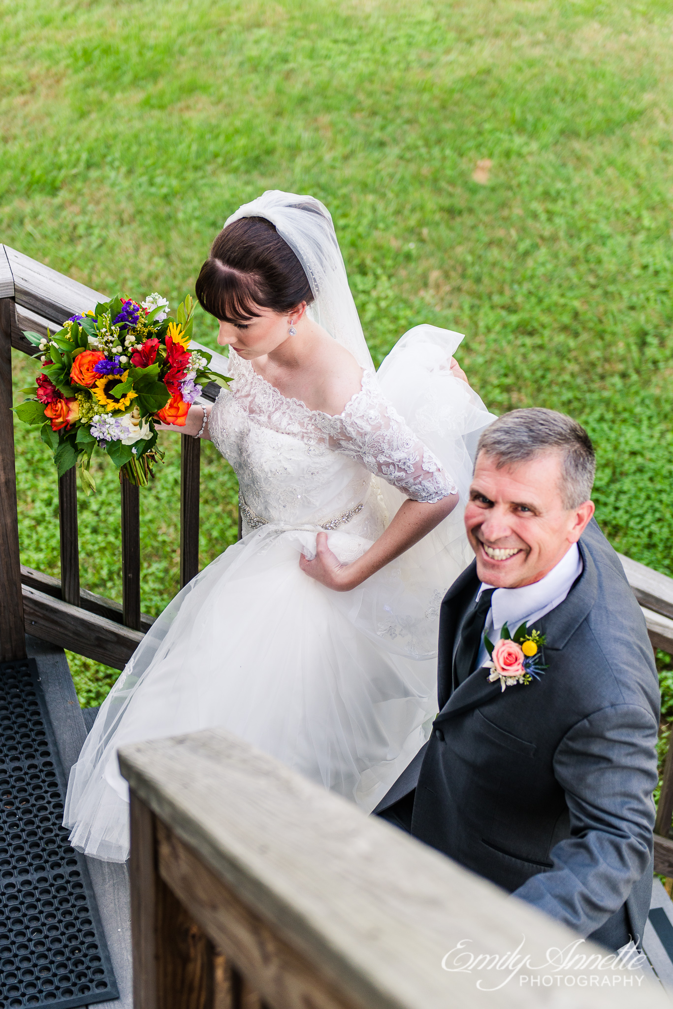 A bride and the father of the bride walk into the ceremony site together during a country wedding at Amber Grove near Richmond, Virginia