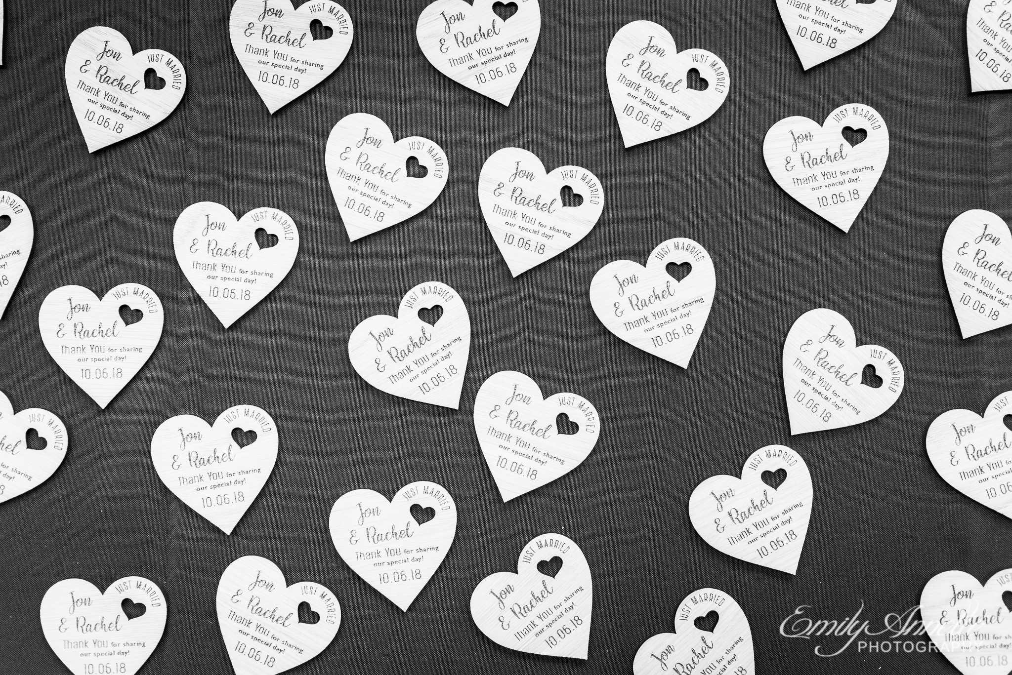 A table of wedding favors with wooden magnet hearts with personalized engraving for a country wedding reception at Amber Grove near Richmond, Virginia