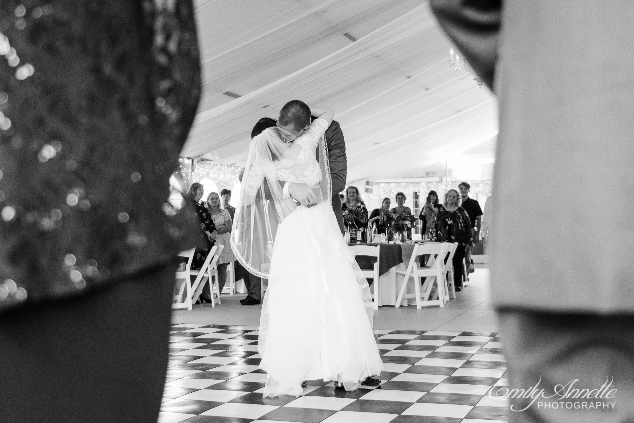 A bride and groom share their first dance as husband and wife during a country wedding reception at Amber Grove near Richmond, Virginia