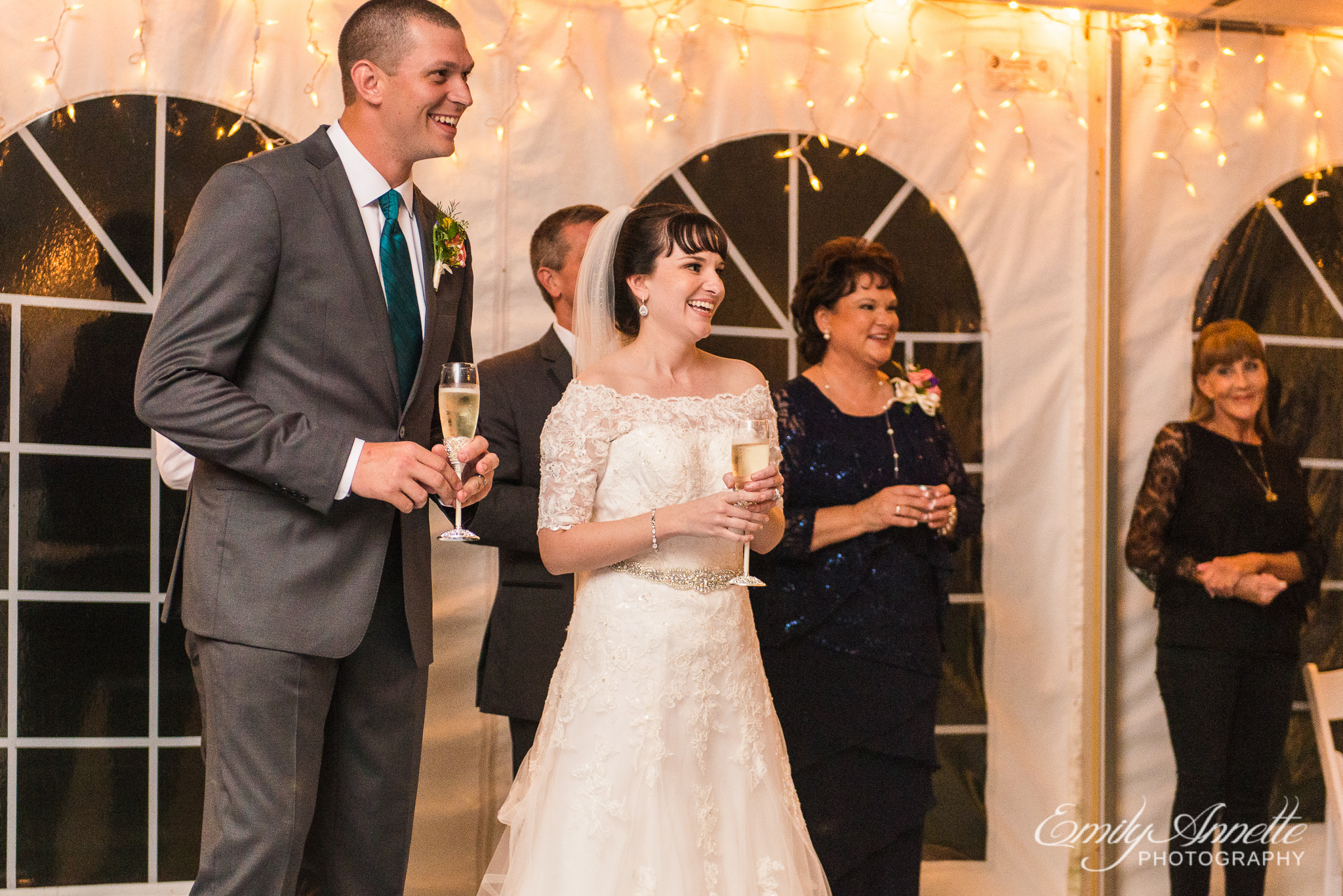 A bride and groom laugh during the toasts of a country wedding reception at Amber Grove near Richmond, Virginia
