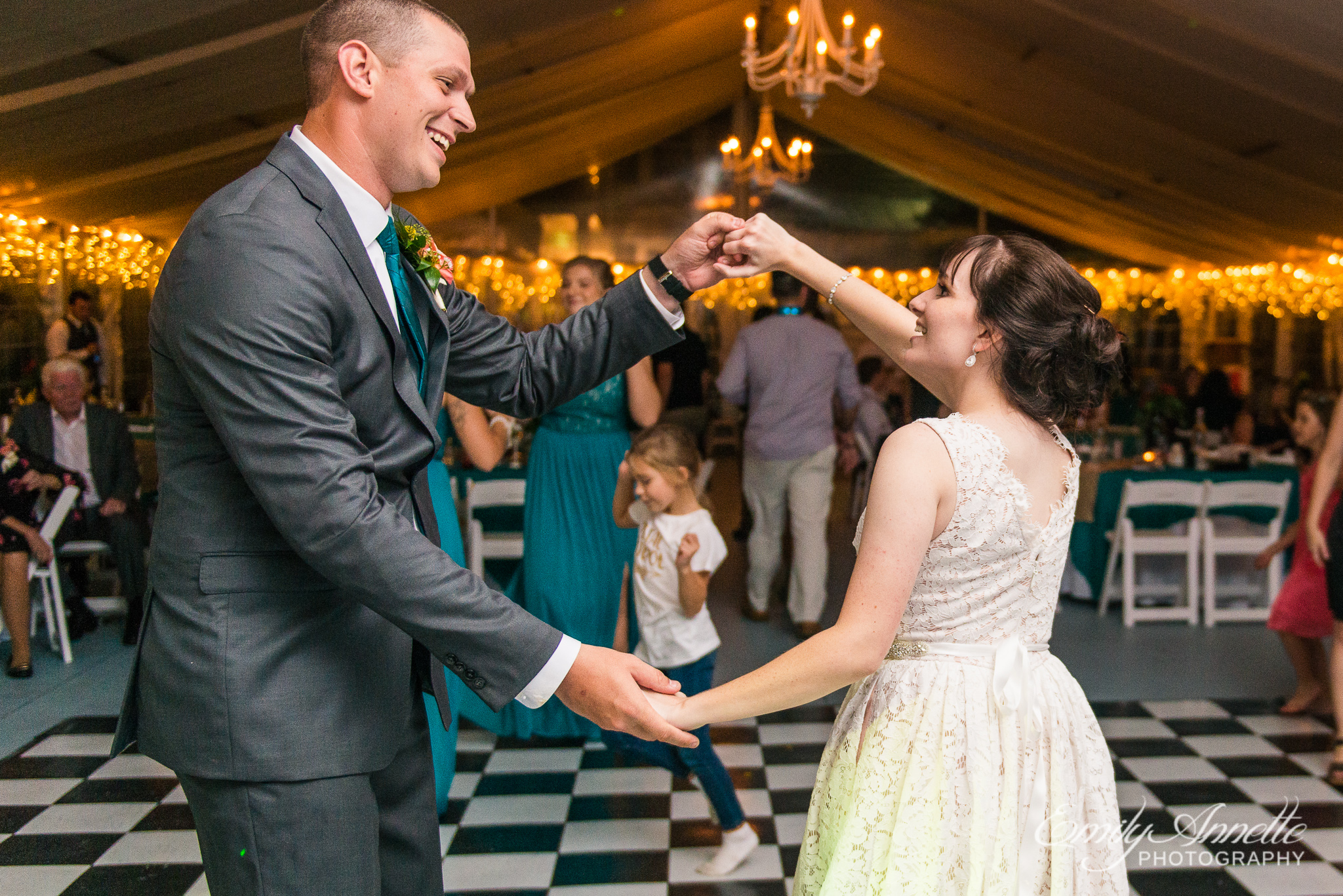 A bride and groom dance together during a country wedding reception at Amber Grove near Richmond, Virginia