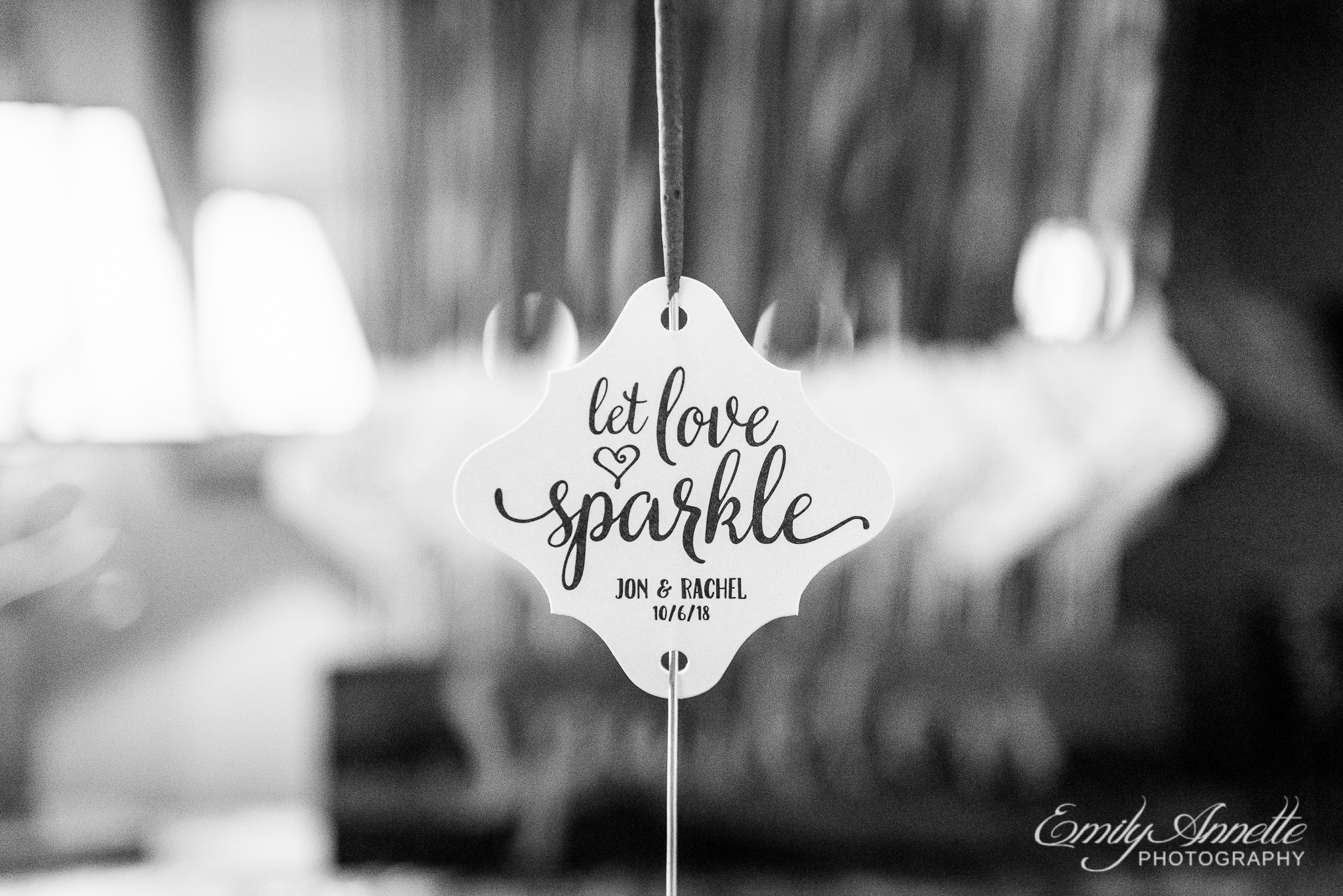 A close up of a sparkler with a note that says Let Love Sparkle before a sparkler exit during a country wedding reception at Amber Grove near Richmond, Virginia