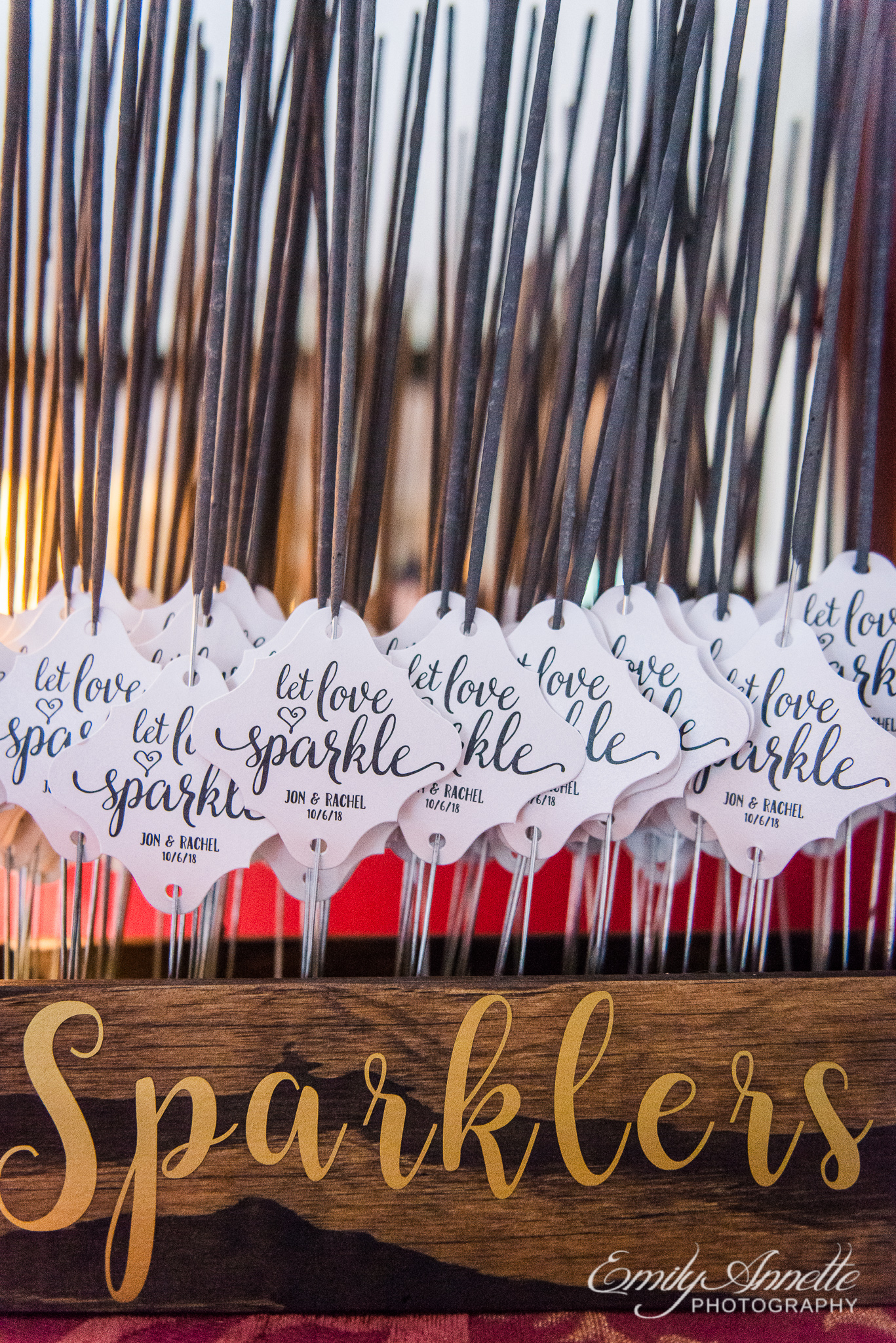 A box of sparklers with notes that say Let Love Sparkle before a sparkler exit during a country wedding reception at Amber Grove near Richmond, Virginia