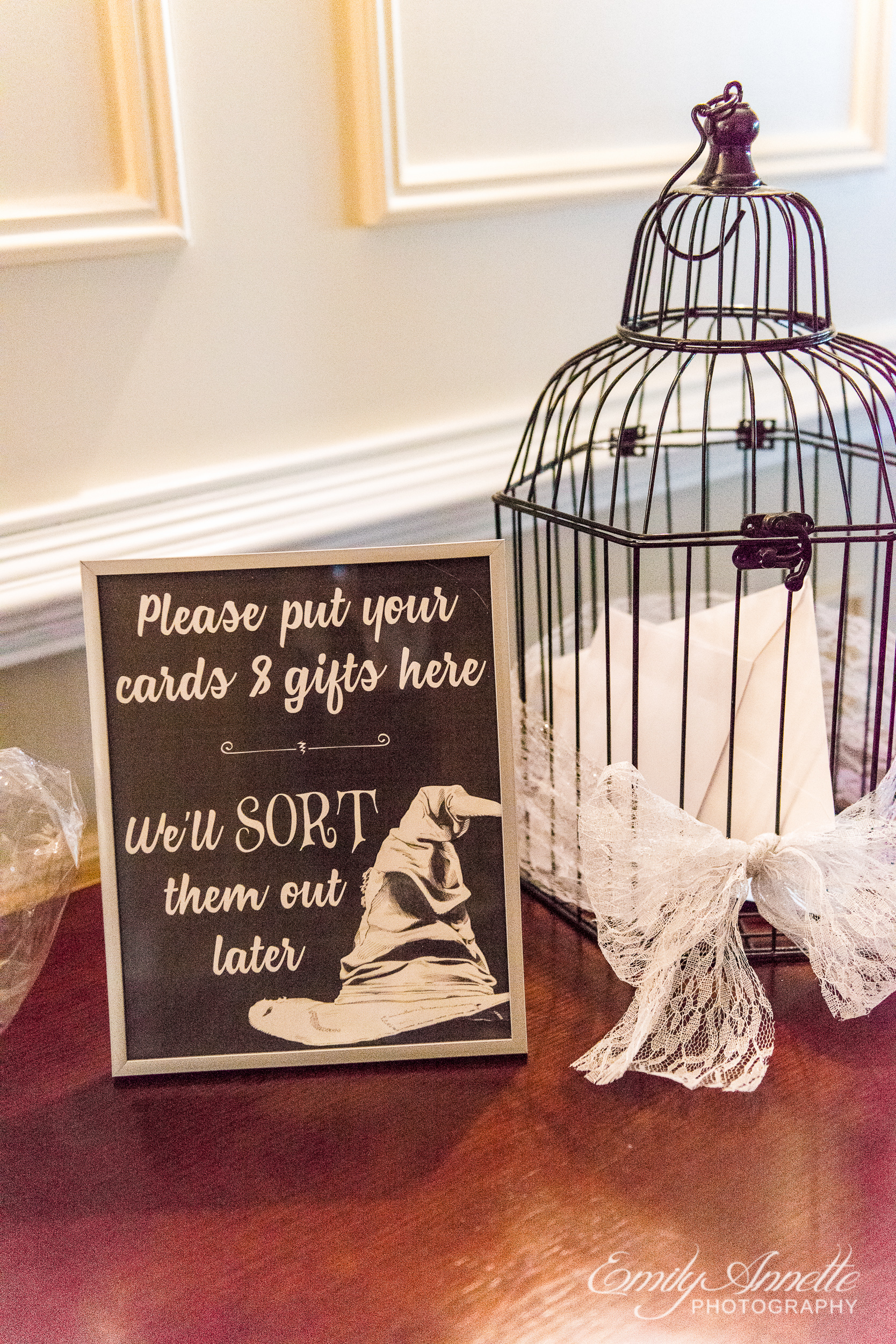 A sign on the gift table that references the Harry Potter sorting hat a wedding reception at Willow Oaks Country Club in Richmond, Virginia