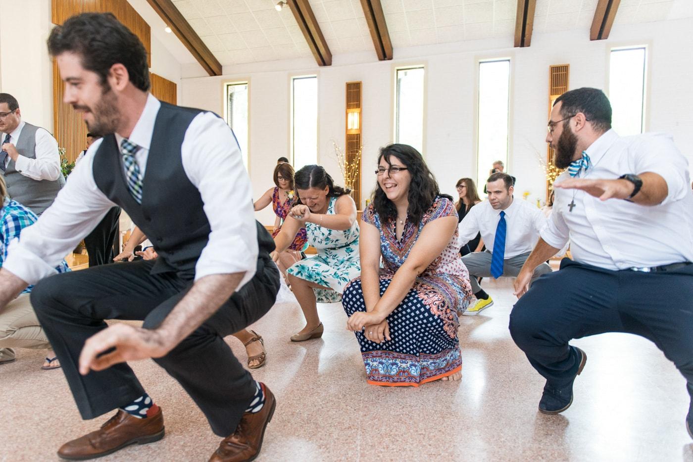 Guests dancing and having fun at a wedding reception at St. Mark Catholic Church in Vienna, Virginia