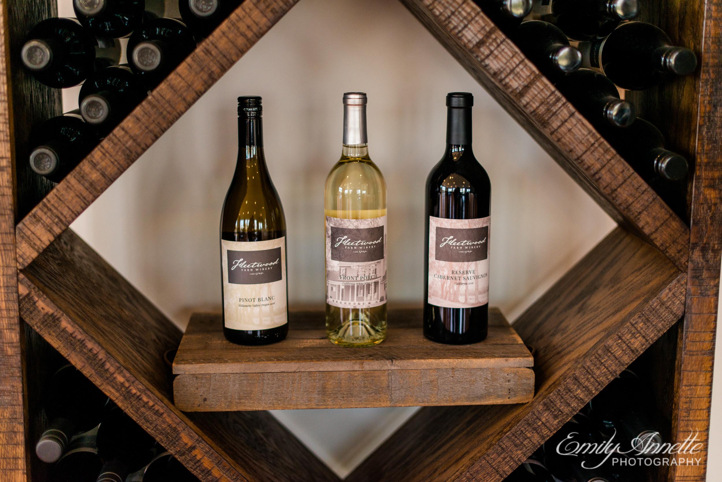 Details of wine bottles displayed at a wedding at Fleetwood Farm Winery in Leesburg, Virginia
