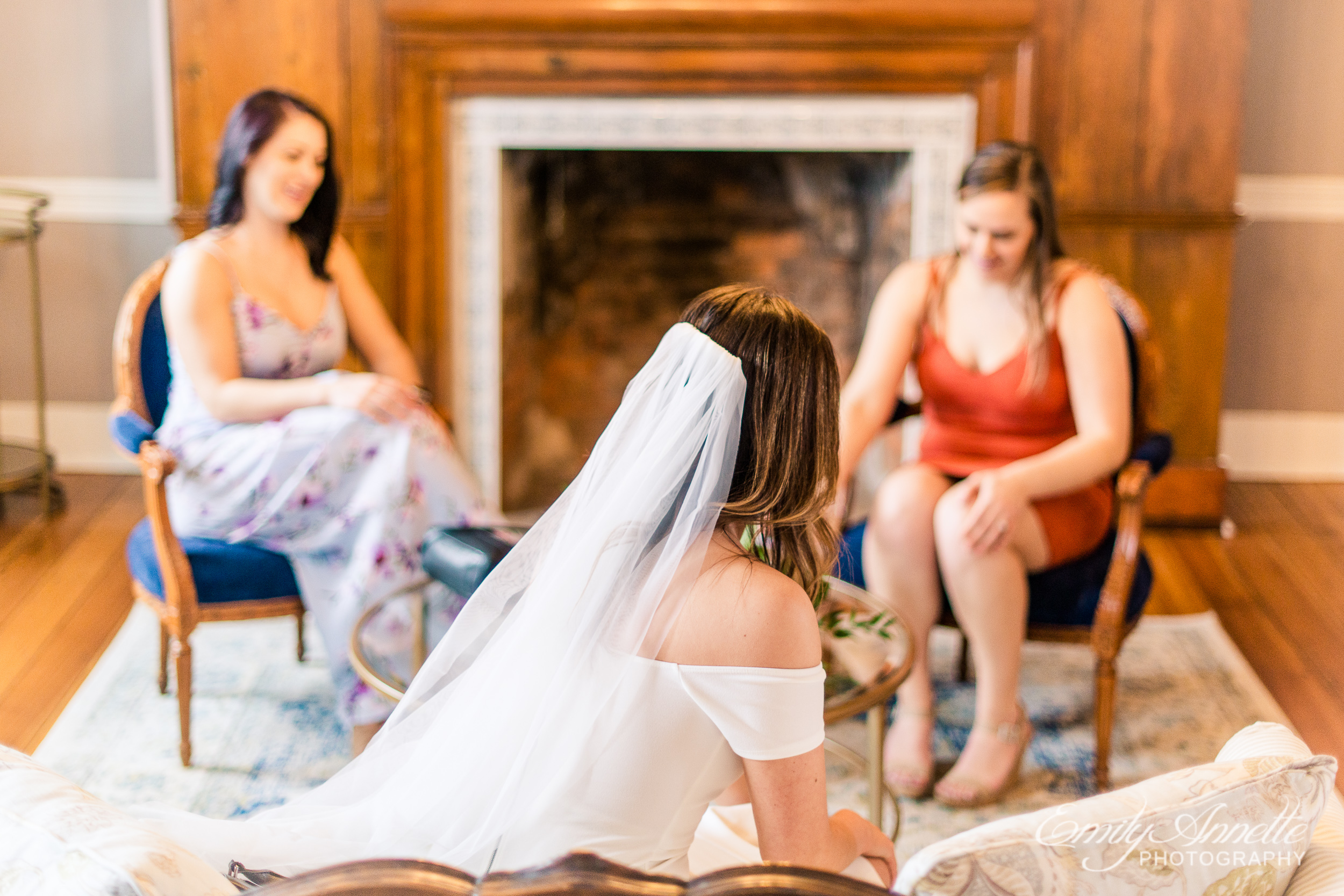 A bride getting ready with her bridesmaids in the bridal suite for her wedding at Fleetwood Farm Winery in Leesburg, Virginia