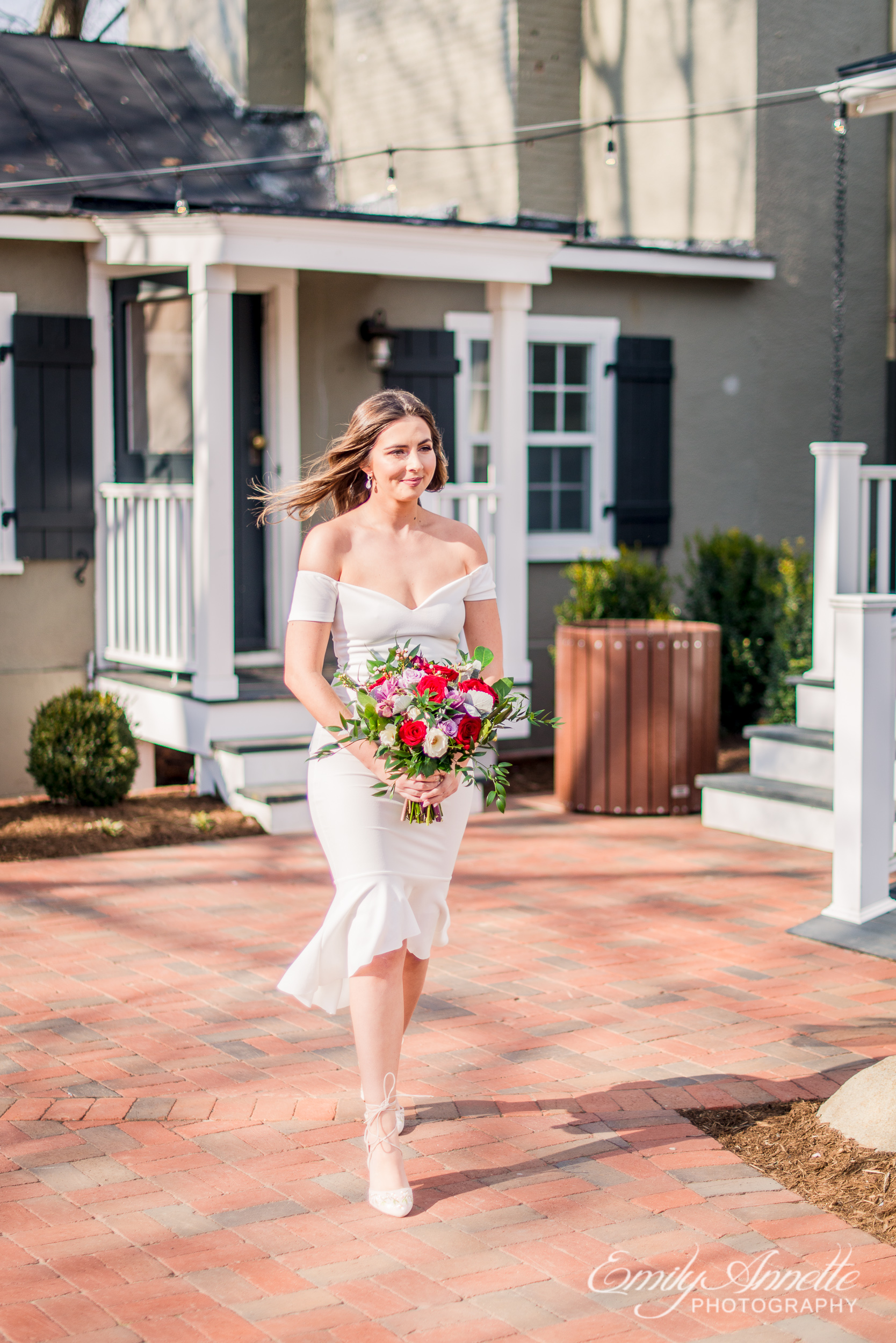 A bride walking down the aisle during her spring wedding at Fleetwood Farm Winery in Leesburg, Virginia