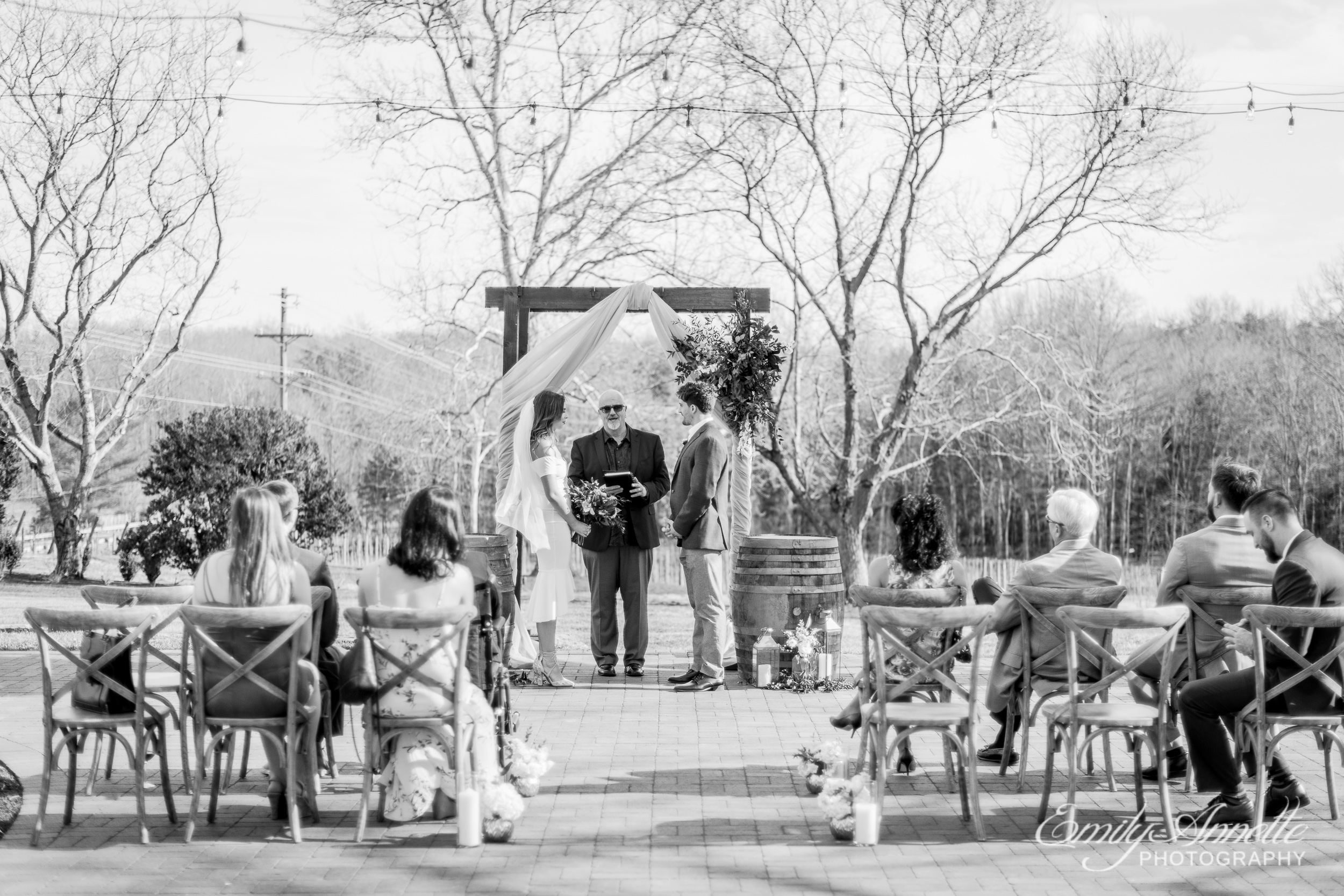 A wide view during an elopement wedding ceremony at Fleetwood Farm Winery in Leesburg, Virginia