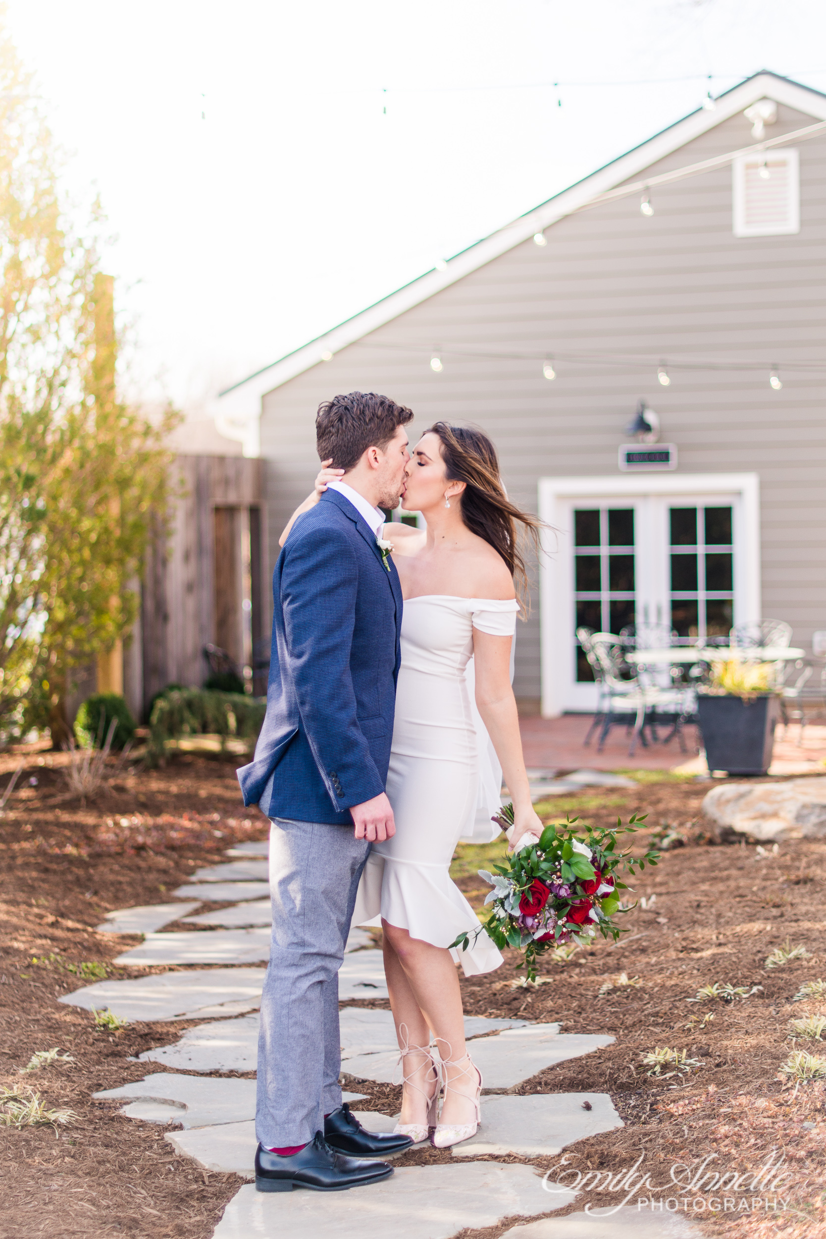 A bride and groom share a sweet kiss on their wedding day at Fleetwood Farm Winery in Leesburg, Virginia