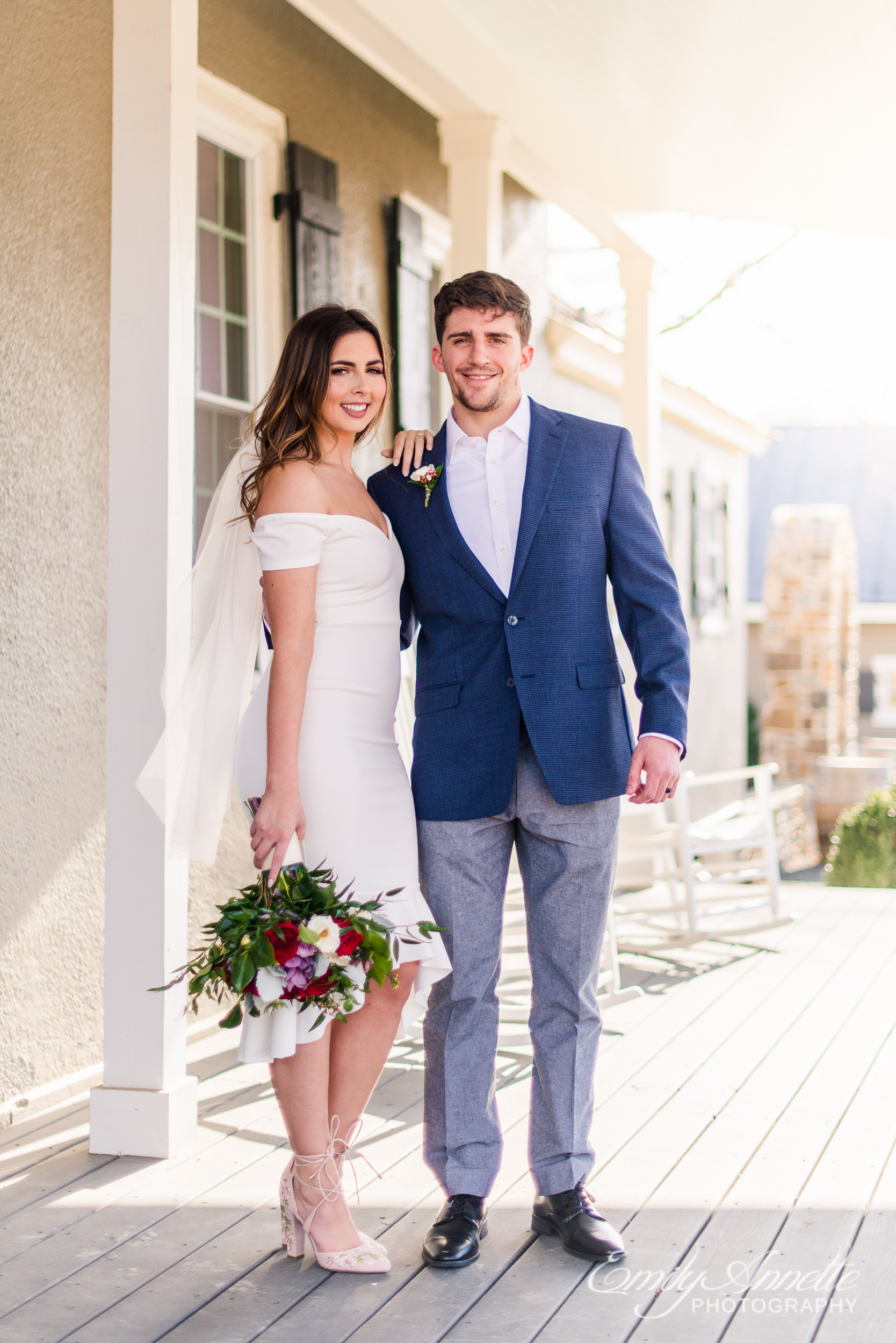 A bride and groom pose for a traditional portrait on their wedding day at Fleetwood Farm Winery in Leesburg, Virginia