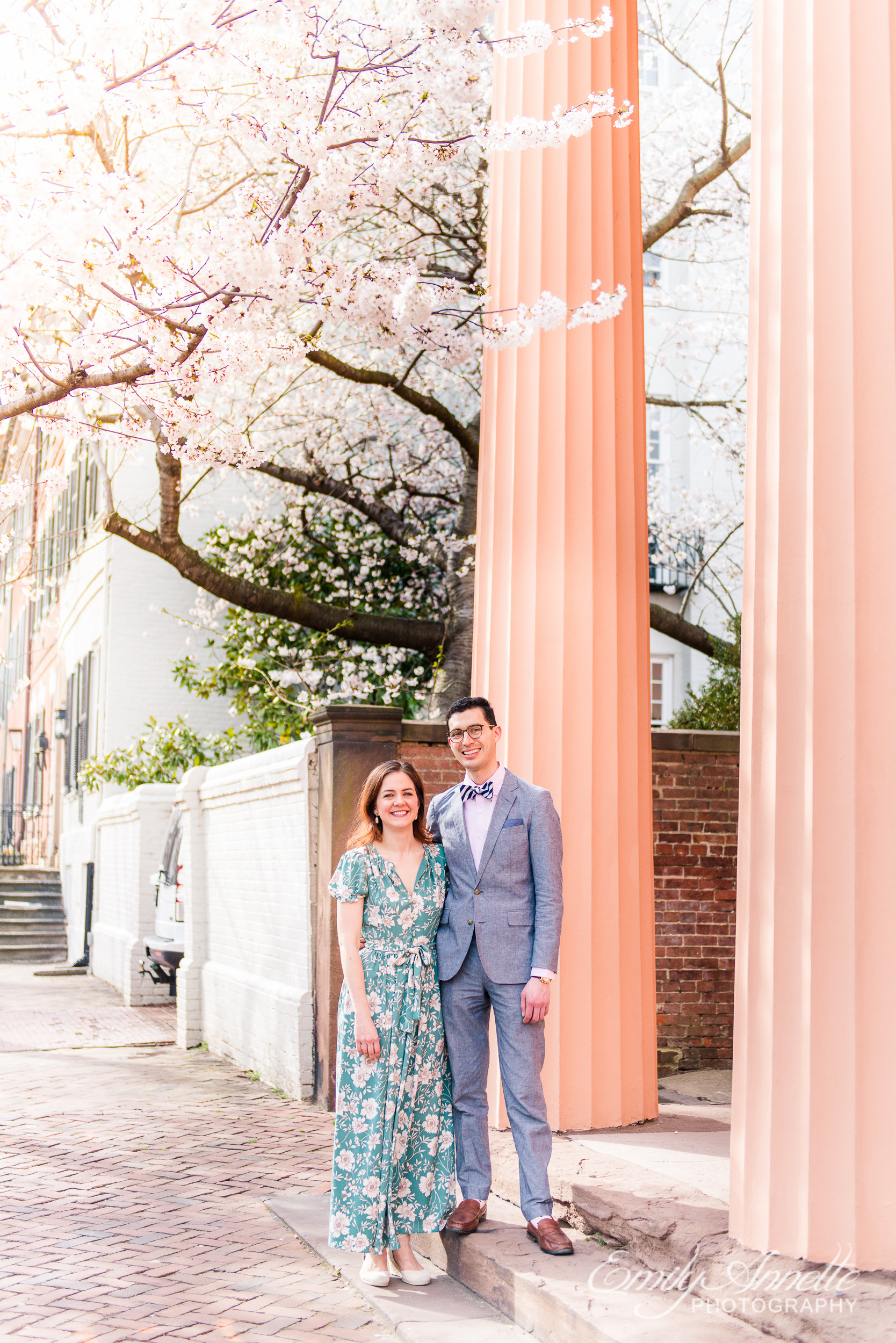A couple poses for a portrait during their spring engagement session in Old Town Alexandria, Virginia