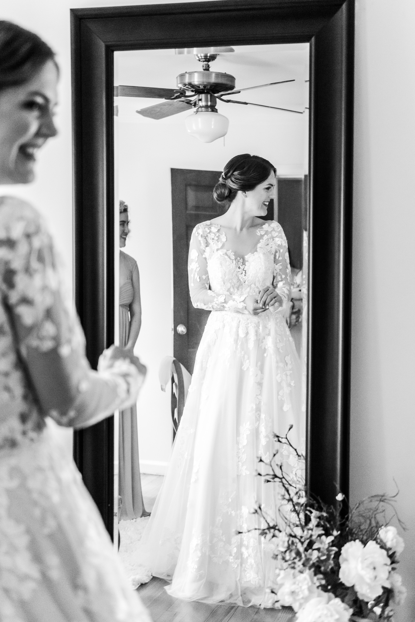 A bride in a modest lace wedding dress with sleeves getting ready in the bridal suite at the Barns at Hamilton Station Vineyard in Leesburg, Northern Virginia before her traditional Catholic wedding
