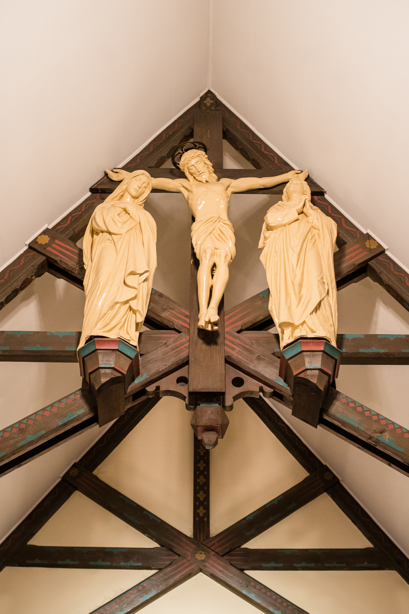 A crucifix and statues displayed in the Chapel of Immaculate Conception in Leesburg, Northern Virginia